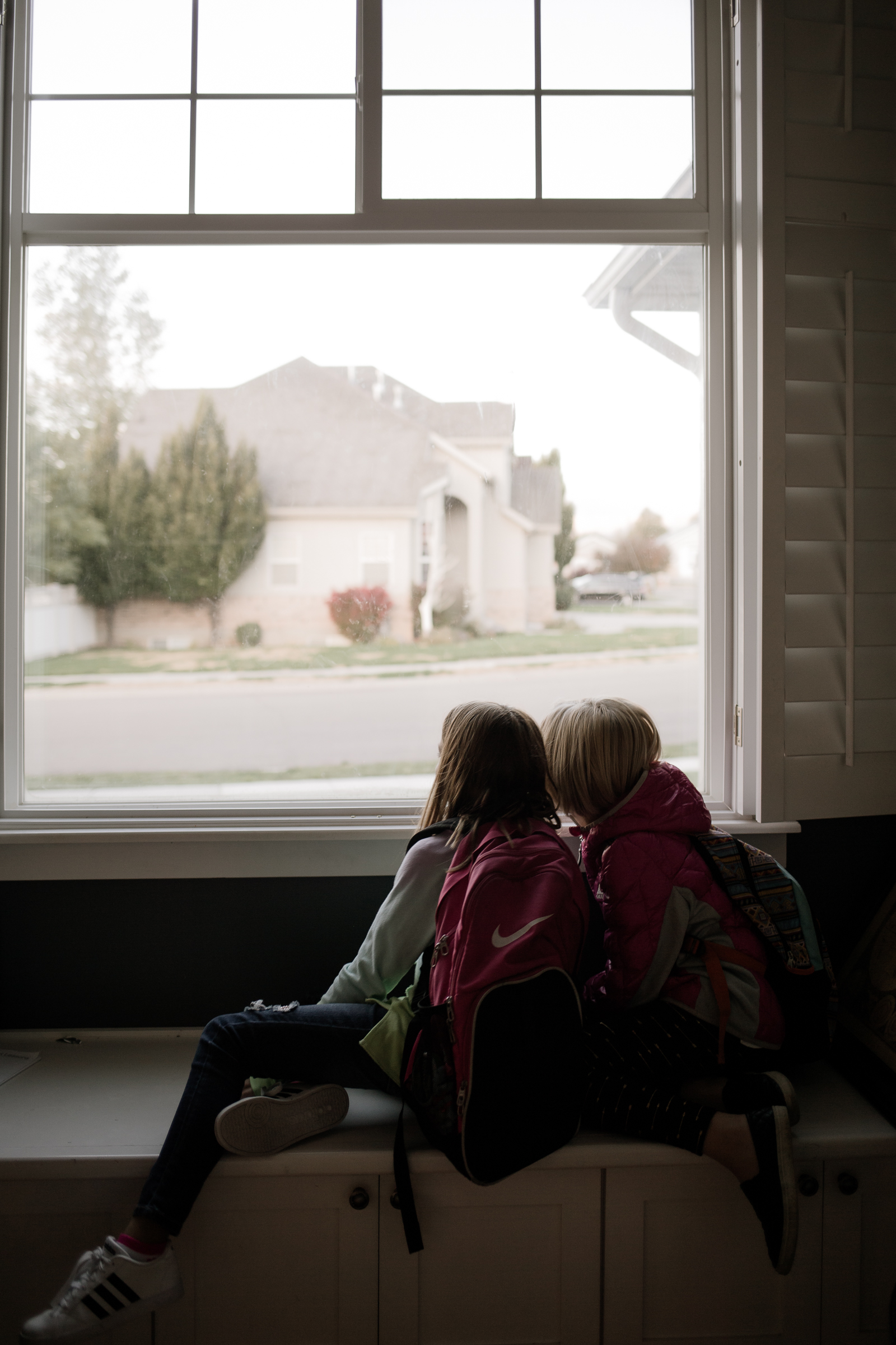 This image is of my daughter and her friend Summer waiting for their carpool. I just loved the soft cool morning light. This window is usually blown out completely when I shoot near it, so I liked how you could really see out to the road and the neighborhood. It also shows their little friendship that is strong and volatile, like sisters.