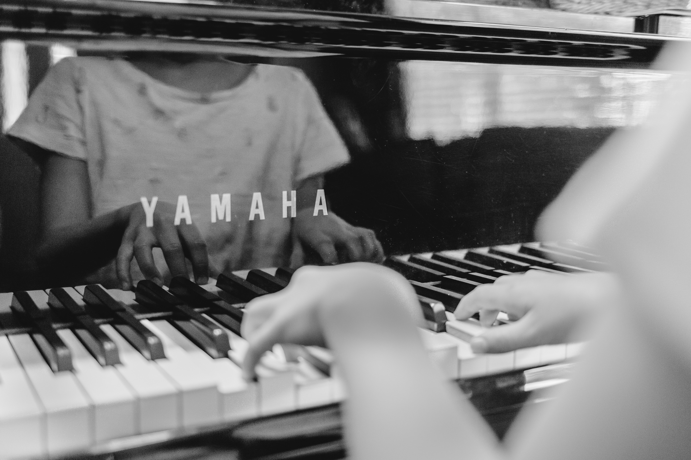 I always love the reflection of Jane's hands in the piano during her lesson.