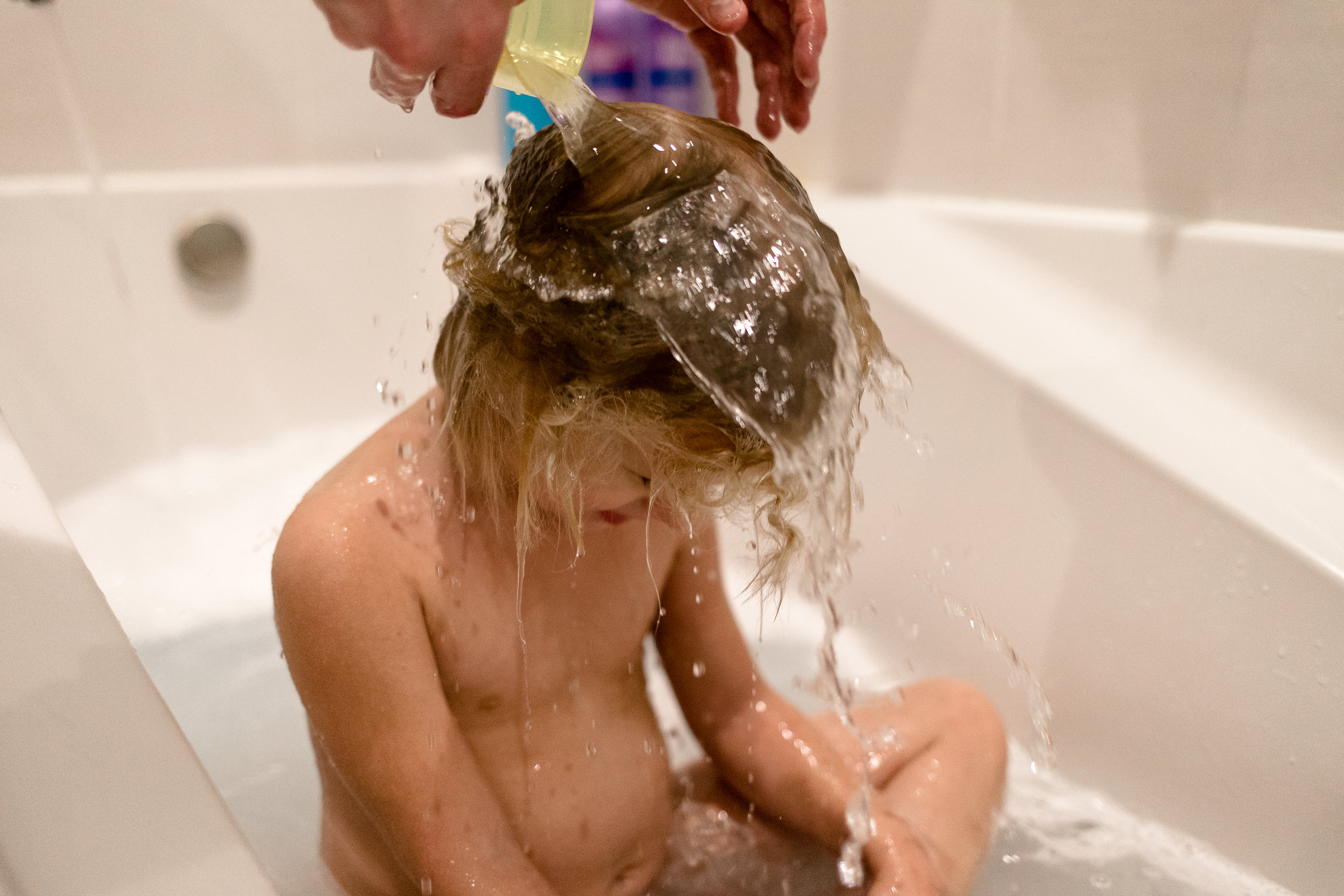 Daddy washing her hair.