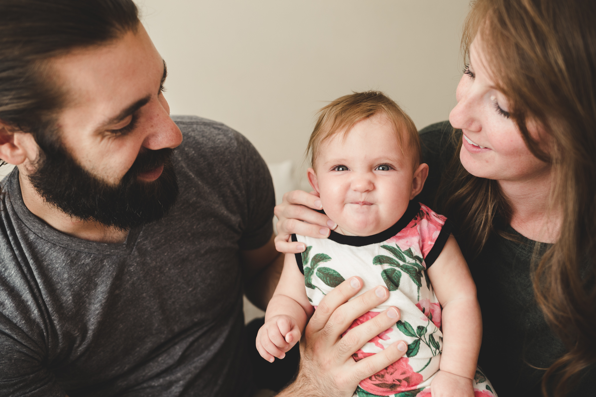 Funny face baby girl with mom and dad - Lifestyle family photography Utah