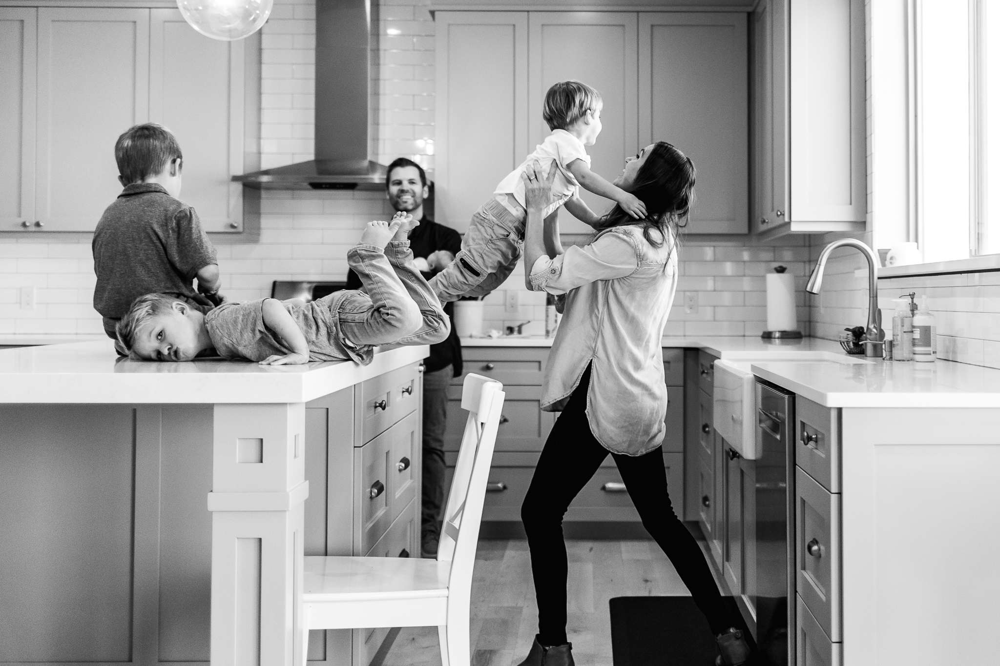 Brothers playing on kitchen counter - Utah family lifestyle photographer
