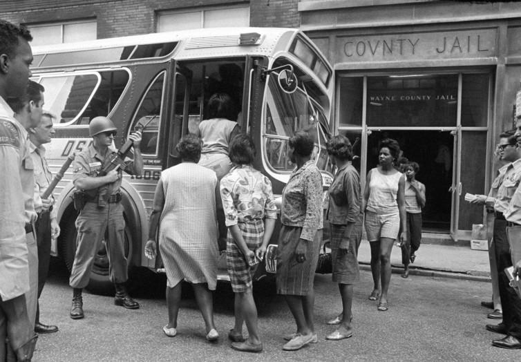 Detroit 67 women loaded onto bus for transport from Wayne County Jail.jpg