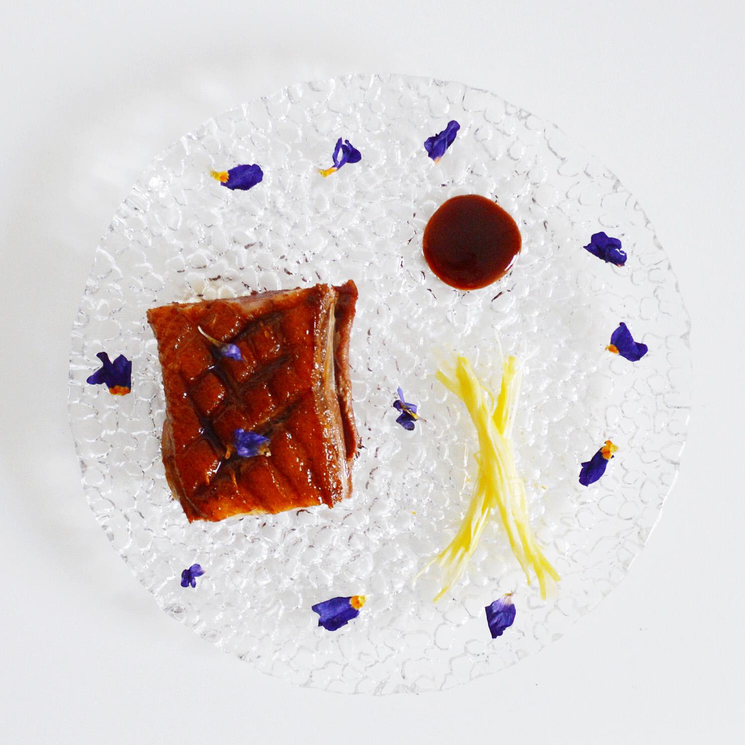 Magret de Canard with Braided Leeks, Plum Sauce and Flower Petals