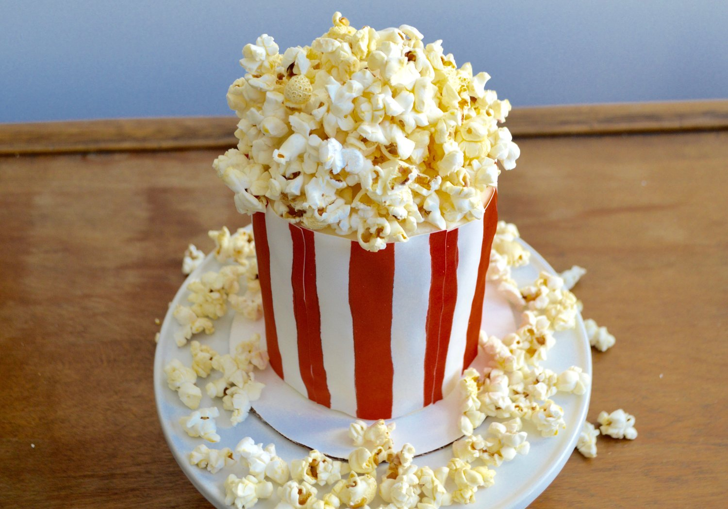 Tall vanilla cake dressed with  American Flag Chefanie Sheets  & popcorn