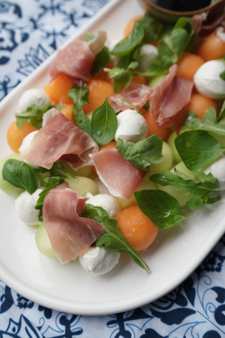 Summer Melon Salad over  Blue & White Tablecloth