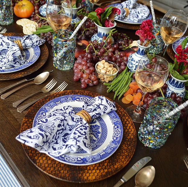 The table is set to celebrate the summer harvest! The local organic bounty is the centerpiece of the meal — in every sense. And with an edible centerpiece, guests can nibble between courses... 🍇🍑🍅🥜🥦 Shop our napkins, napkin rings, ceramic straws, and urns at Chefanie.com