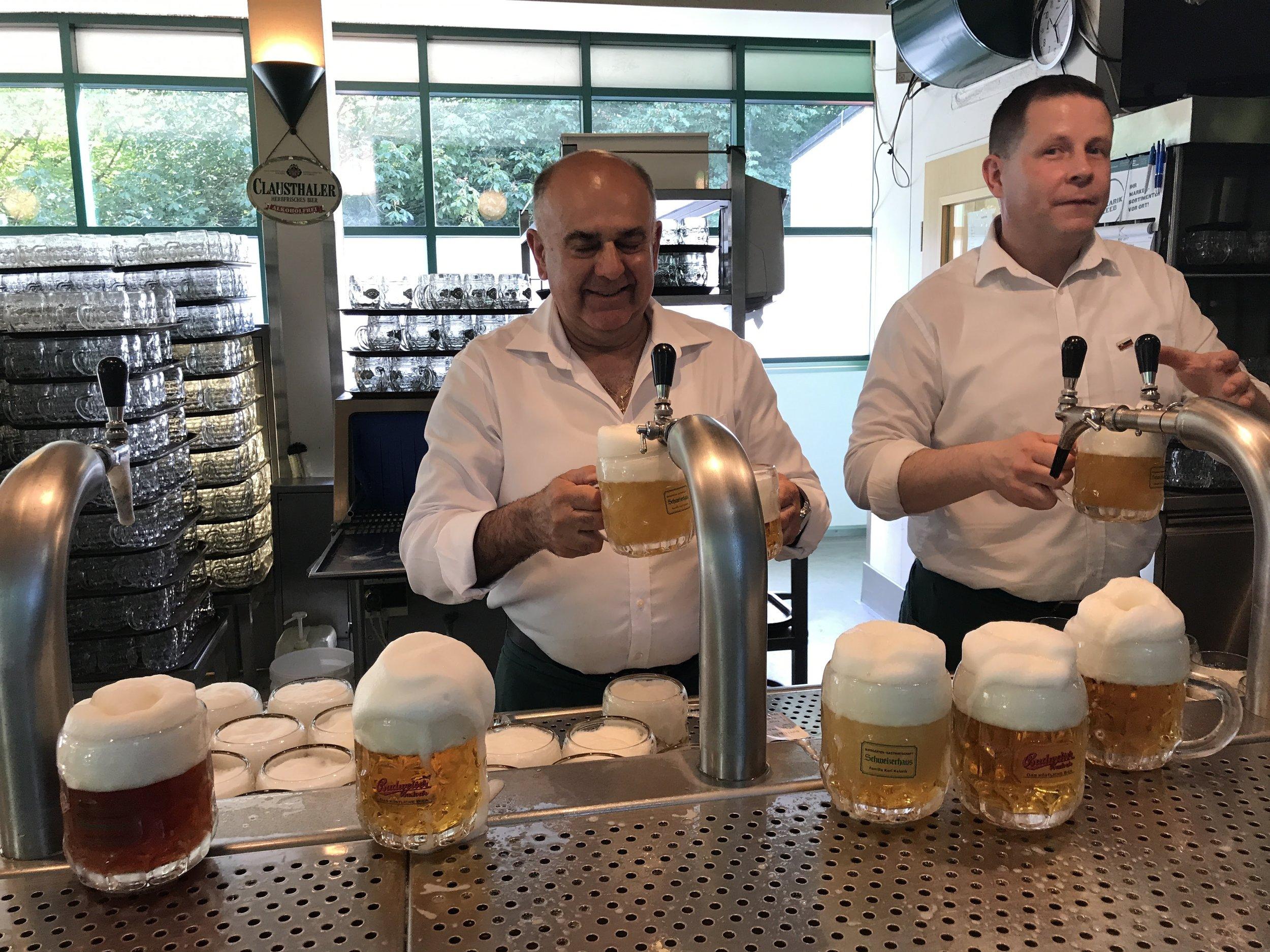 Pouring beer at the outdoor beer hall, Schweierhaus