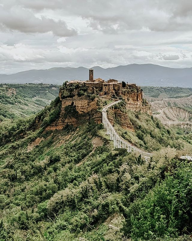 Now that I'm home, it's latergrams for a while. This is Civita di Bagnoregio, which is now a ghost city. It experienced many disasters over the years, driving the locals away. We admired it from afar as tour buses dropped group after group at the bridge. . . . . . . #pixel3 #teampixel #mytinyatlashello #mytinyatlas #theprettycities #prettycity #prettycities #tlpicks #culturetrip #loves_madeinitaly #yallersitalia #ig_italia #viterbo #ghosttown #fromwhereistand #beautifulmatters #pathport #best_italiansites #lovesmadeinitaly