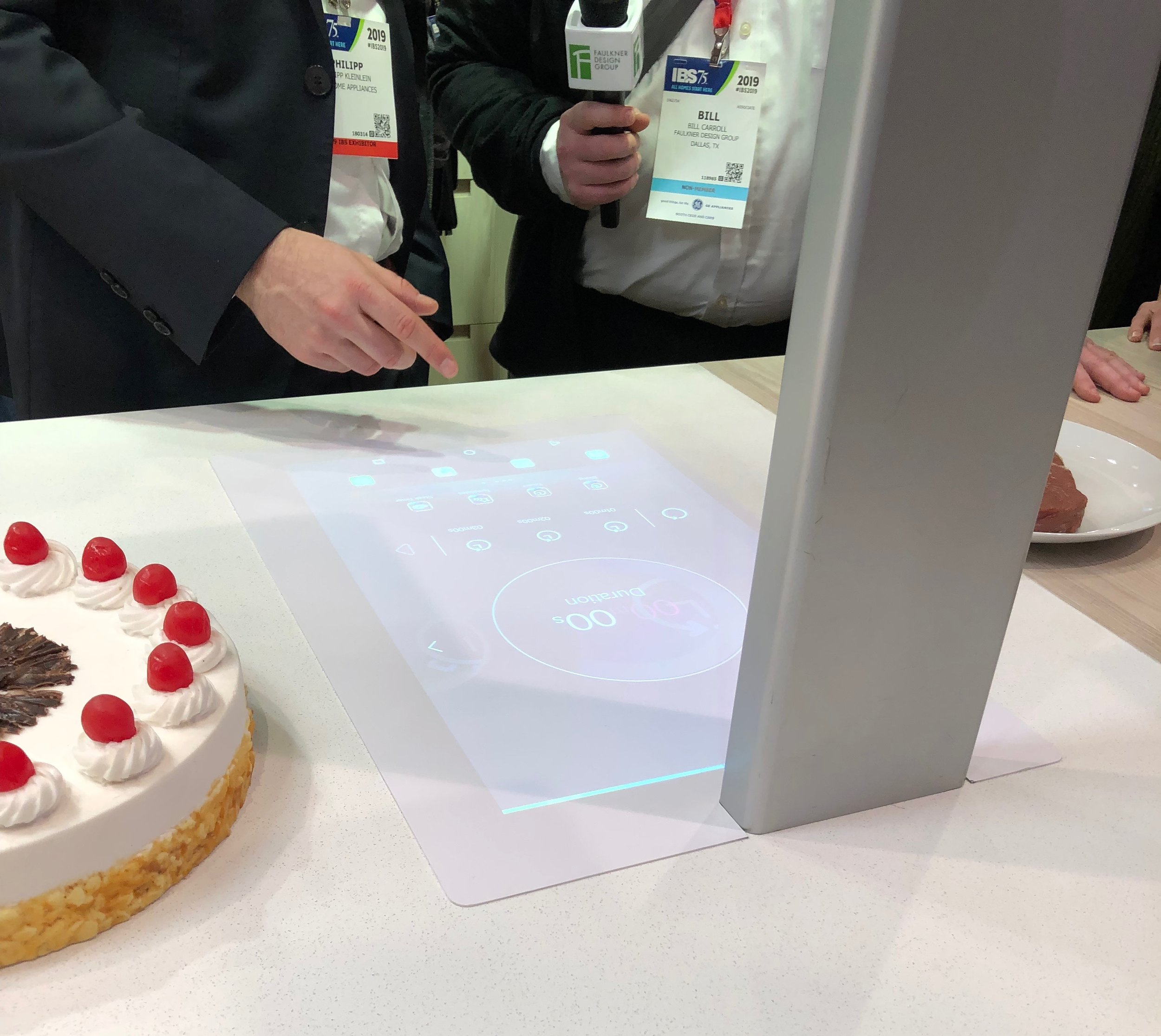Bosch's projector could create lines on your desserts for accurate cutting and even weigh a steak to tell you how long to cook it.