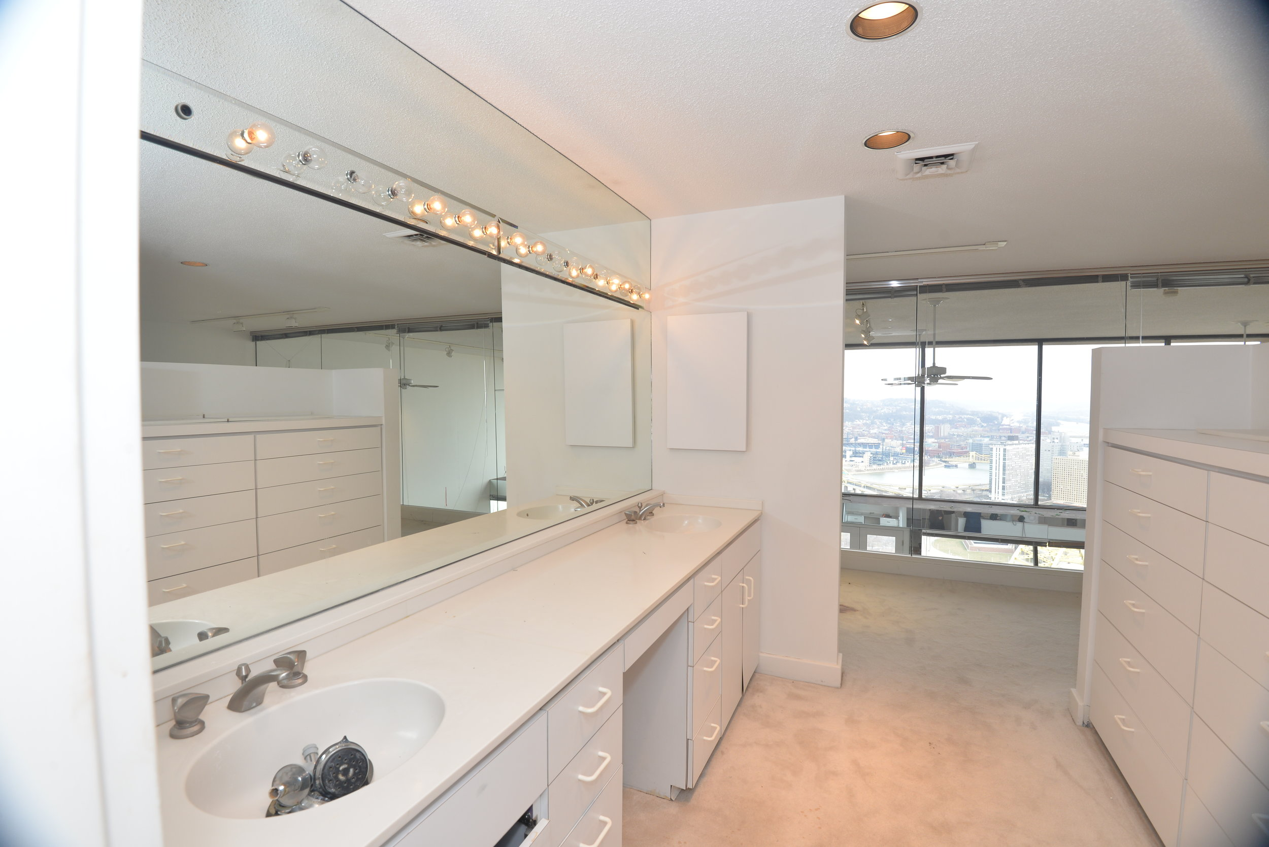 View from original vanity area. The space to the right was an island of drawers in the middle of the bedroom.