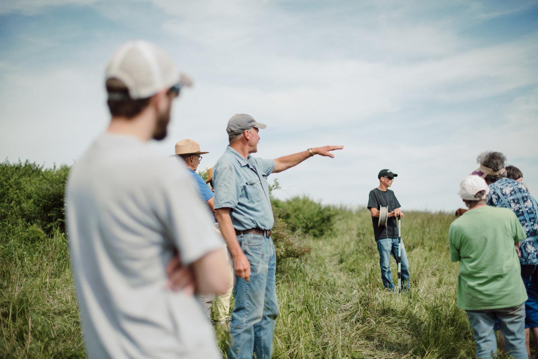 Tour- Dad talking in pasture..jpg