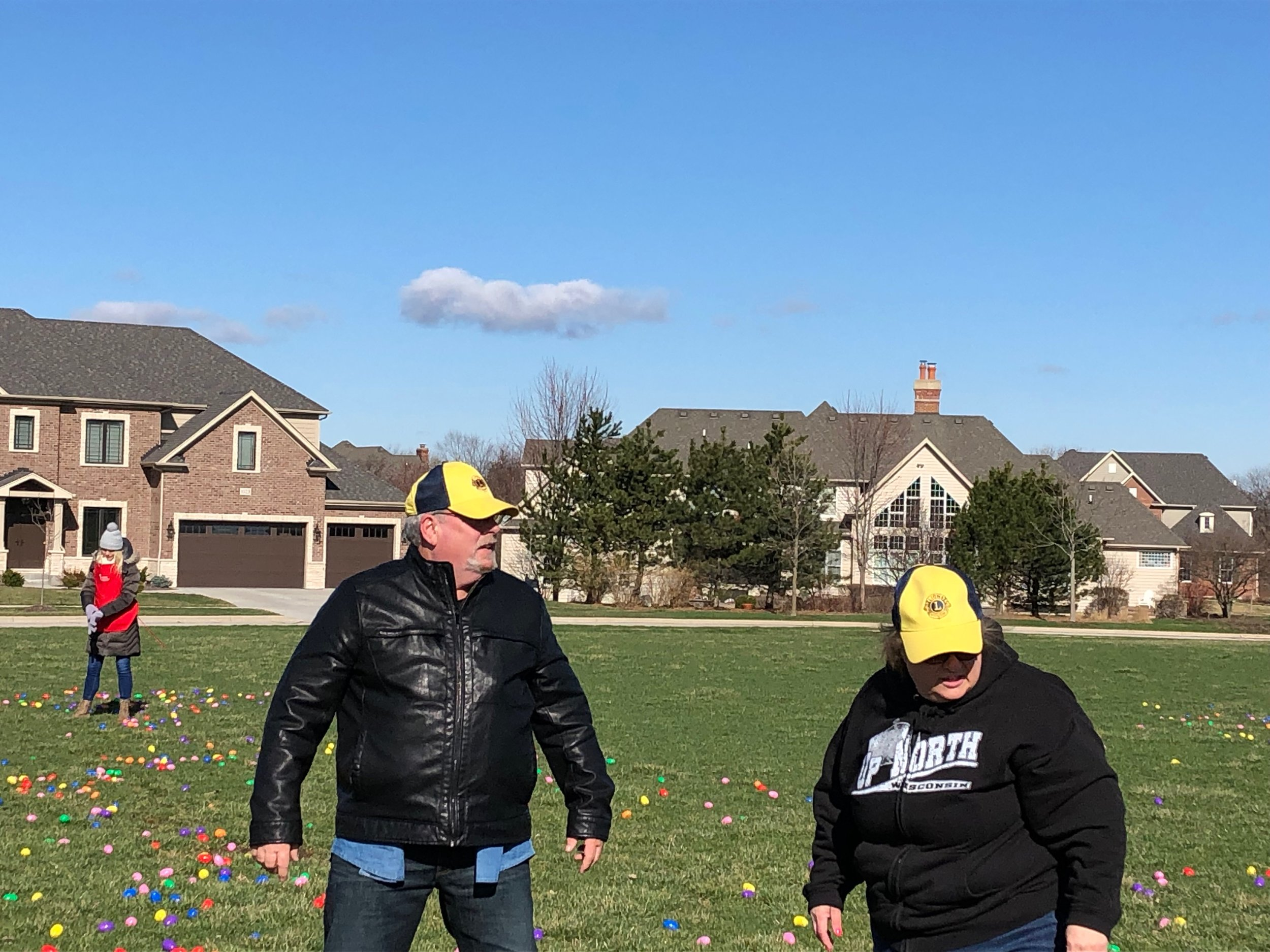 Lions Bill Hills and Paula Black helping with Easter Eggs
