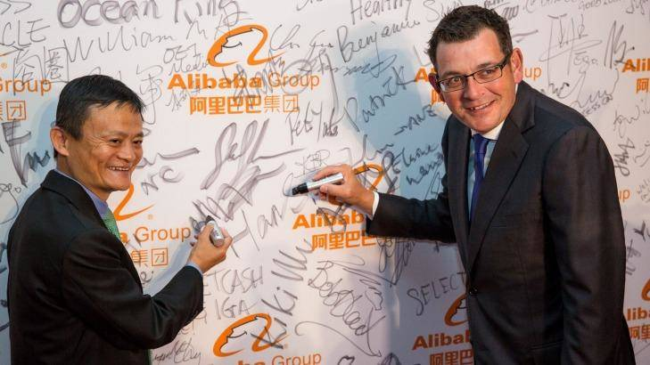 Writing on the wall: Alibaba founder Jack Ma with Premier of Victoria Daniel Andrews at the launch of Alibaba's Australian and New Zealand headquarters. Photo: Stefan Postles