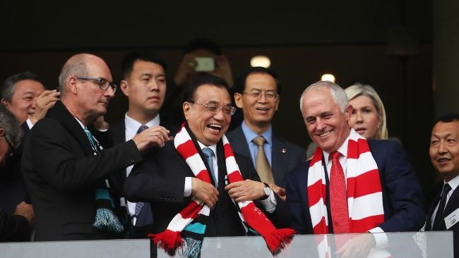 Photo Credit: Li Keqiang with Port Adelaide chairman David Koch, left, and Malcolm Turnbull. Picture. Phil Hillyard
