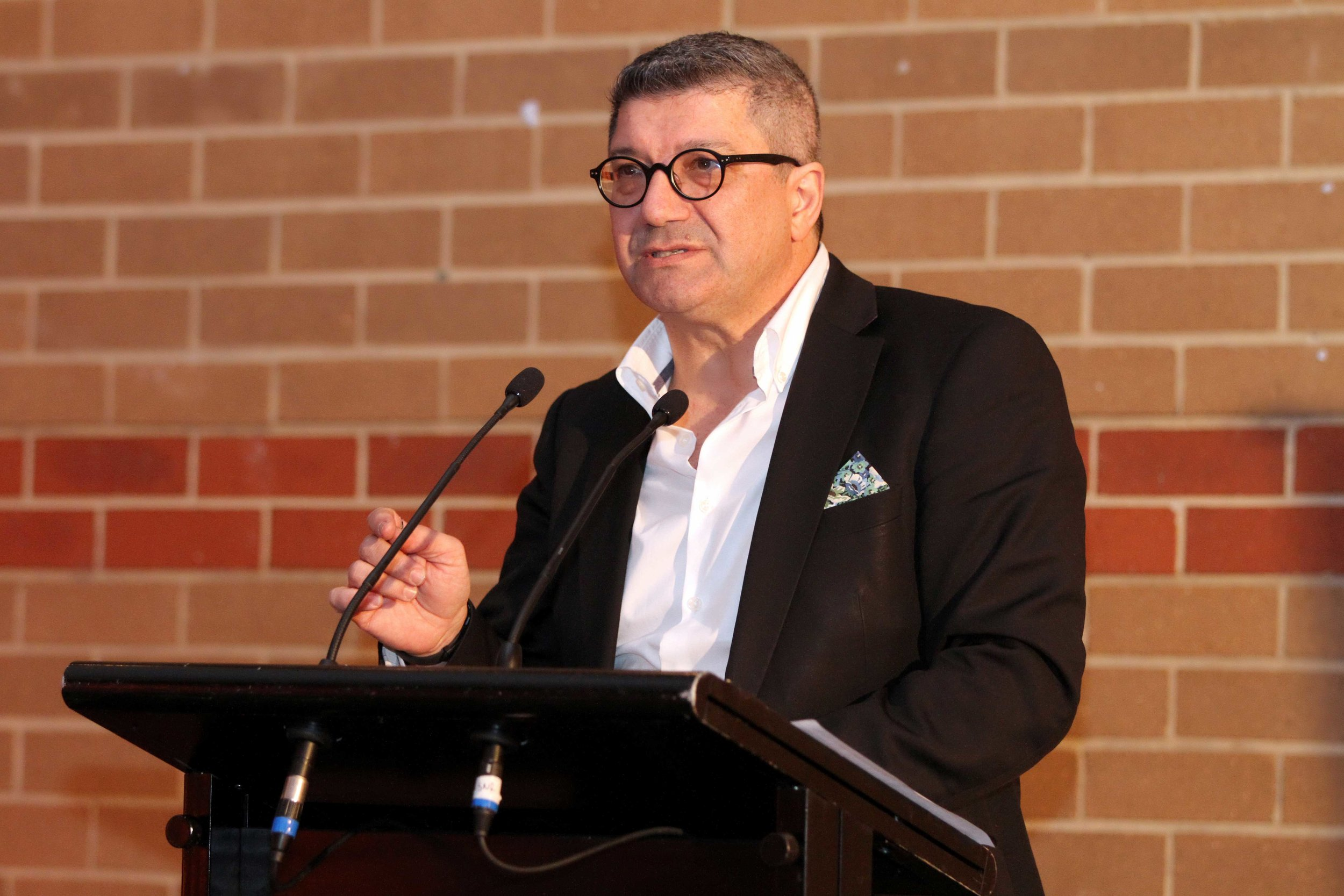 Pino Migliorino AM, Managing Director of Cultural Perspectives Group, speaks at the opening night.