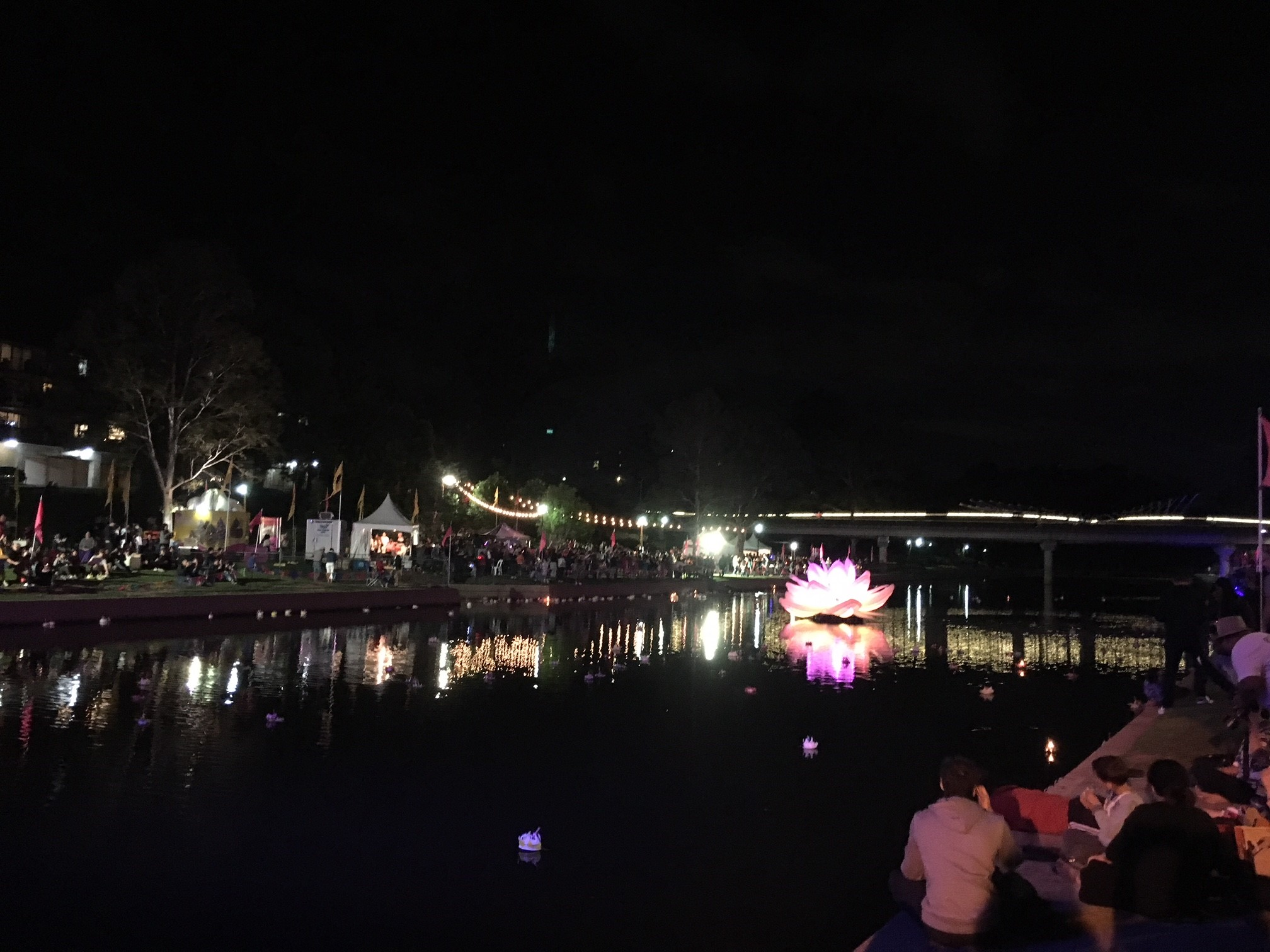 Parramatta river was lit up by a giant lotus flower lantern and lined up by the crowds on the riverbank last Saturday evening.