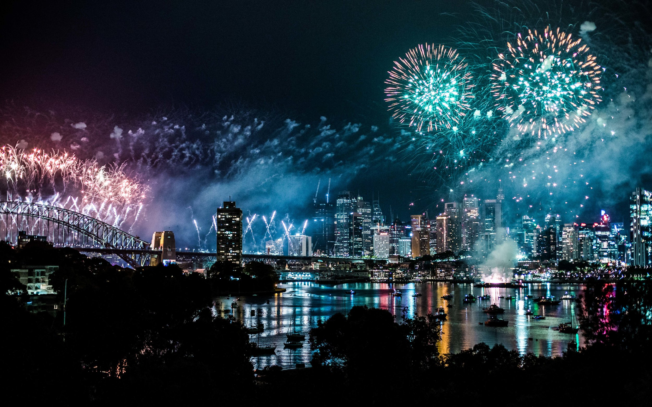 New Year's Eve fireworks at midnight over Sydney Harbour, viewed from the balcony of Sydney Opera House.
