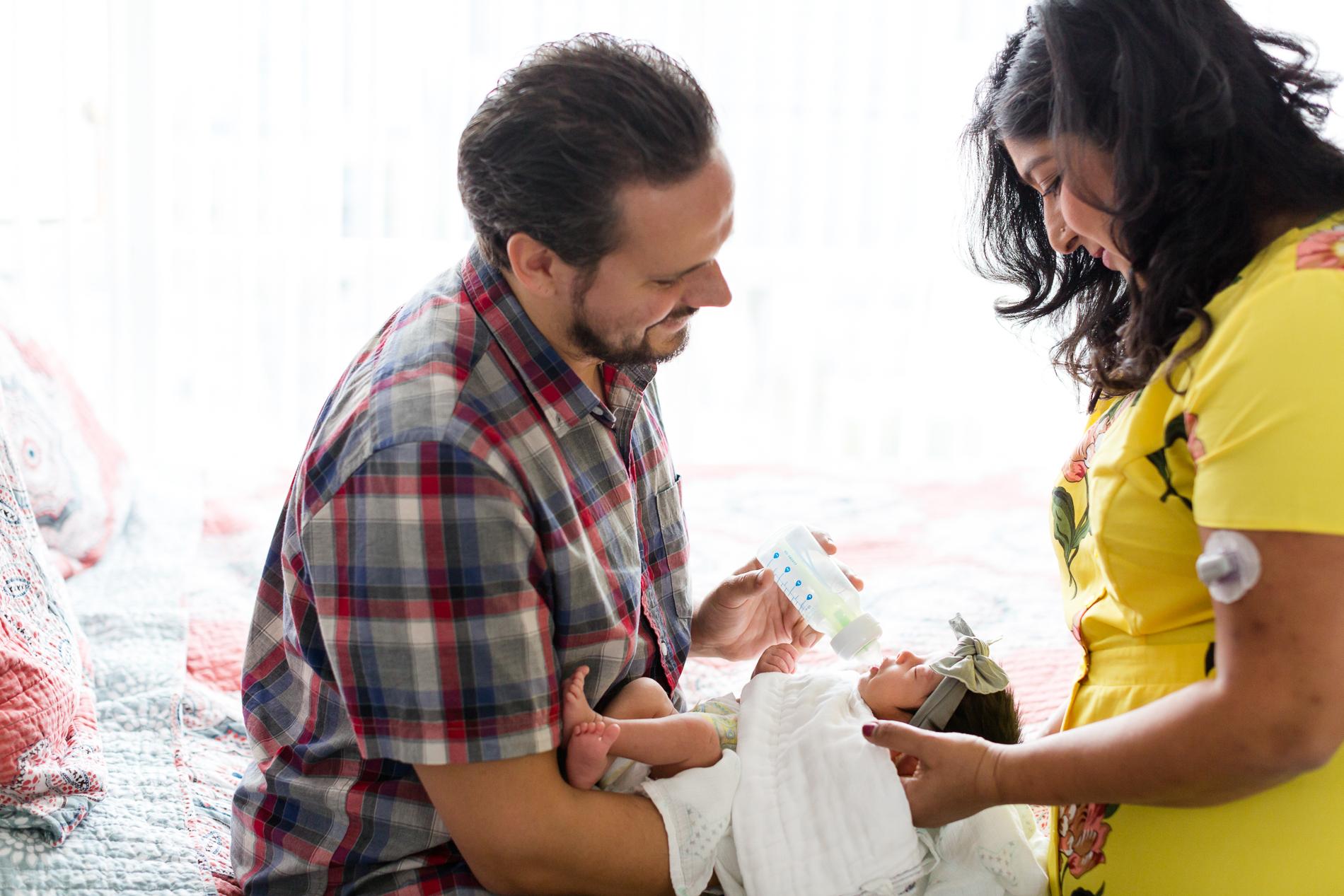 San Diego Newborn Photographer Christine Dammann Photography lifestyle newborn family on bed 3