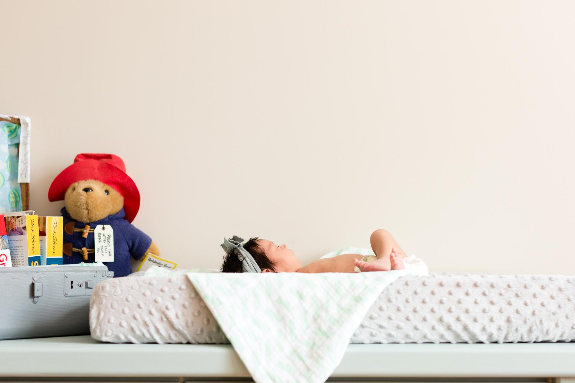 San Diego Newborn Photographer Christine Dammann Photography lifestyle newborn baby on changing table 1