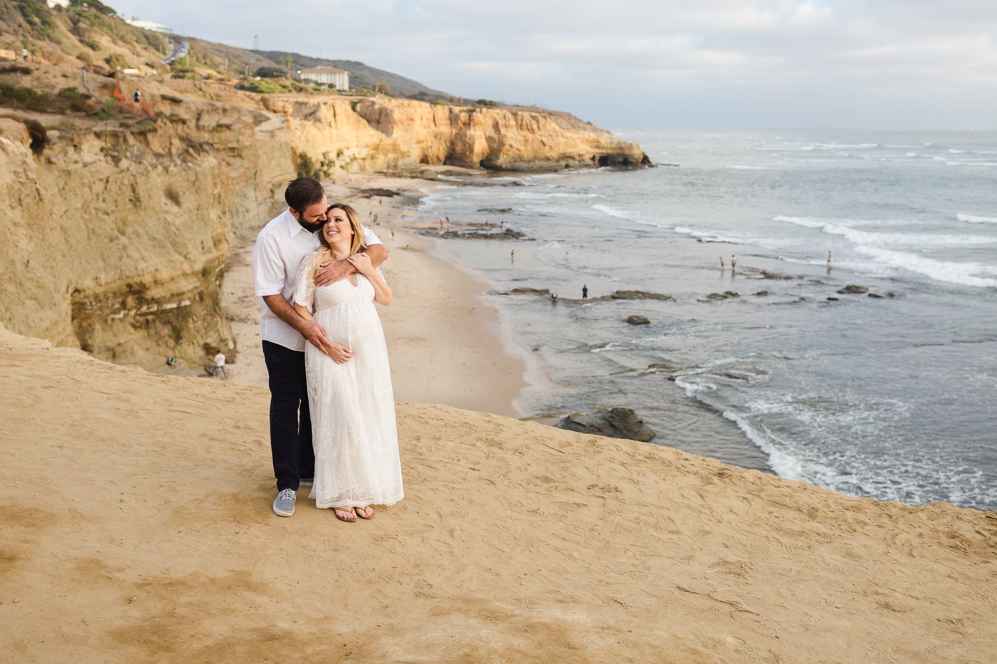 Beautiful Pregnant woman with husband at Sunset Cliffs, Point Loma, San Diego, CA