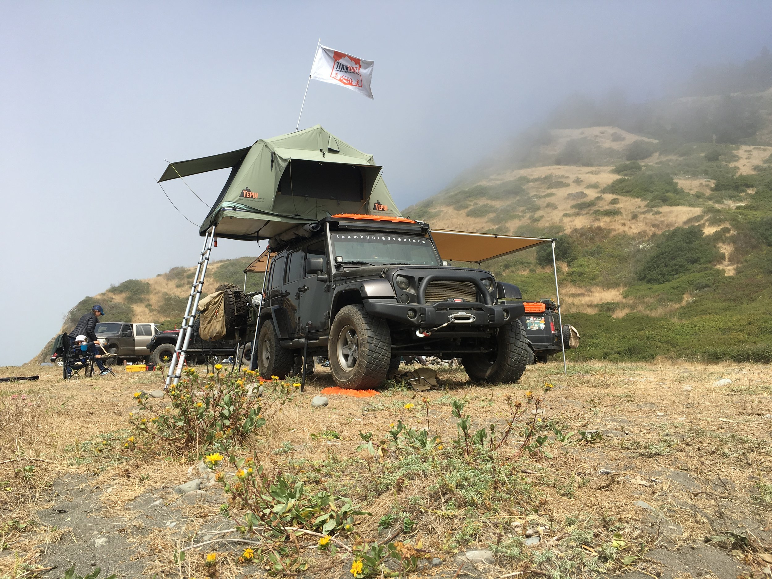The Team Hunt Adventure Jeep fully deployed at Usal Beach.