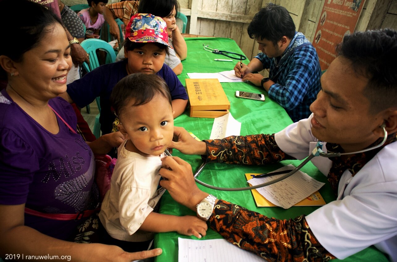 dr. Tiop Pasaribu and Adams Sophiano, volunteer doctors at free medical check-up in Talekoi Village