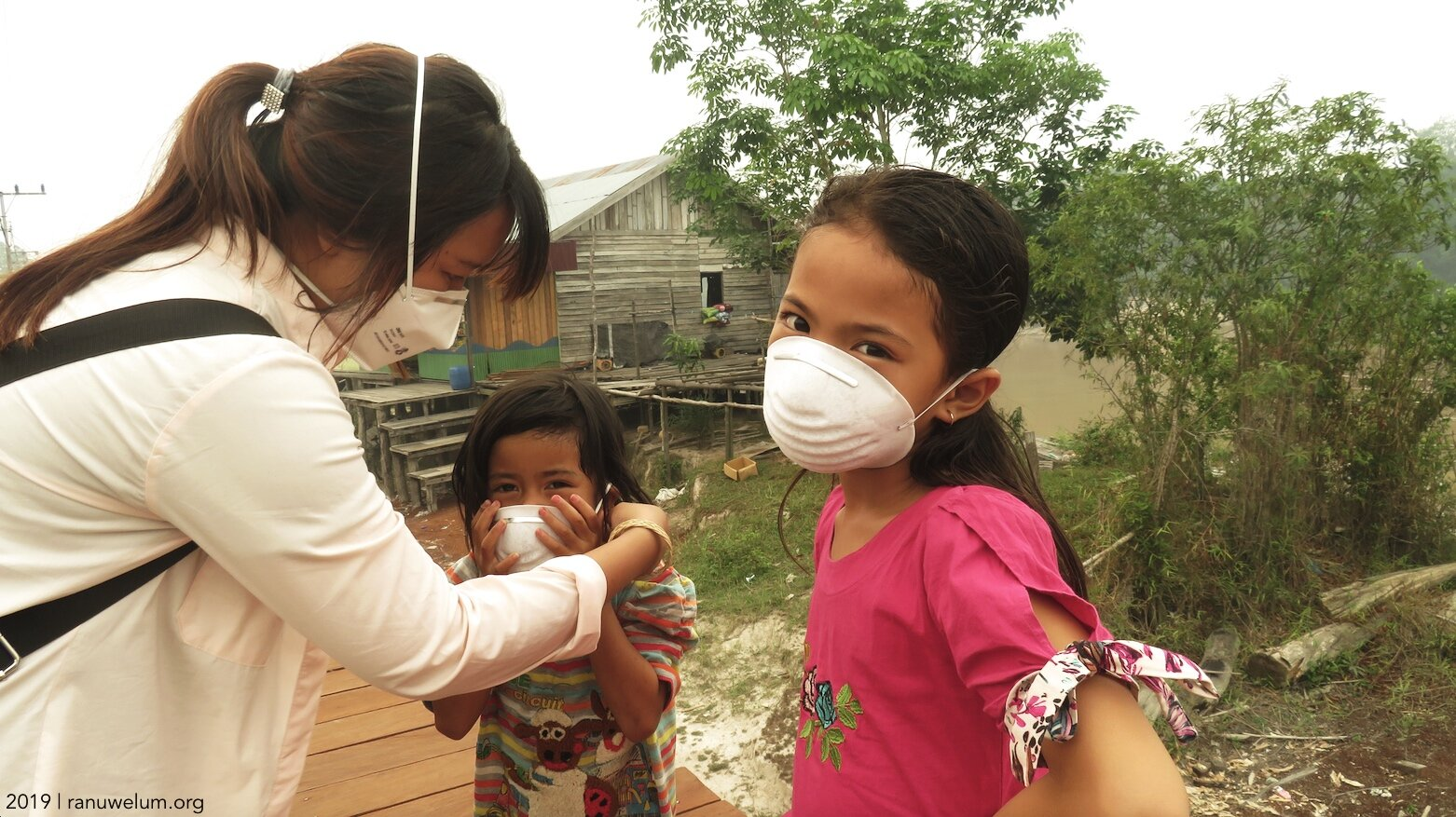 Ranu Welum staff Roro Ardya Garini with the children of Petuk Katimpun village.