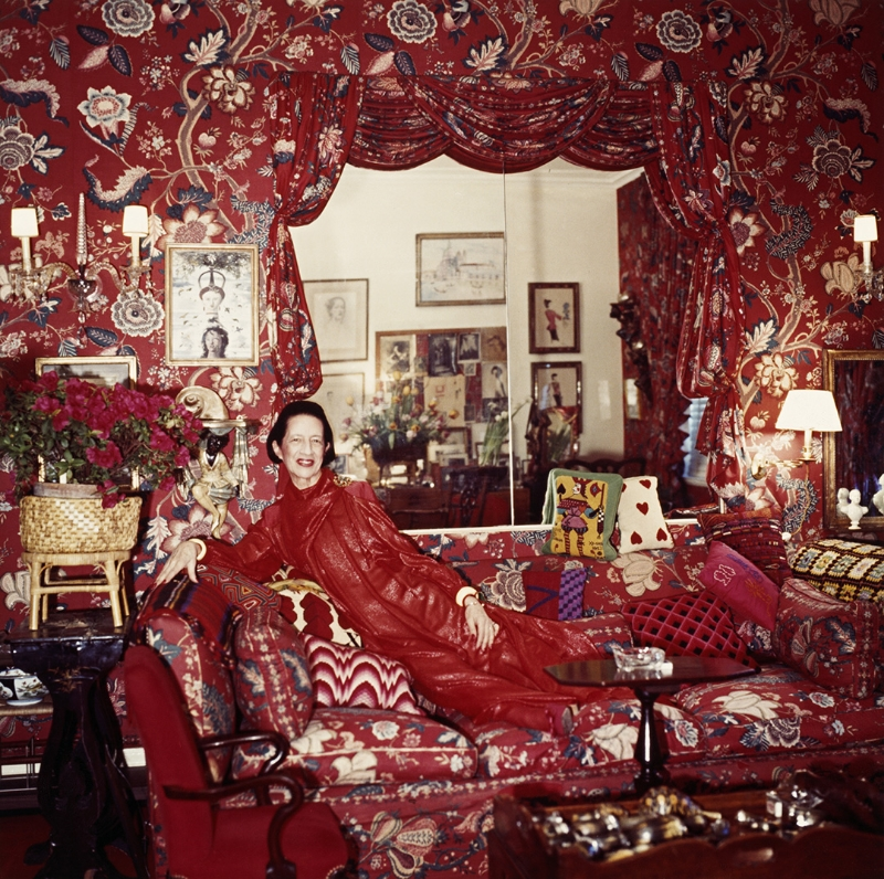 Diana Vreeland surrounded by red furnishings- series, 1979