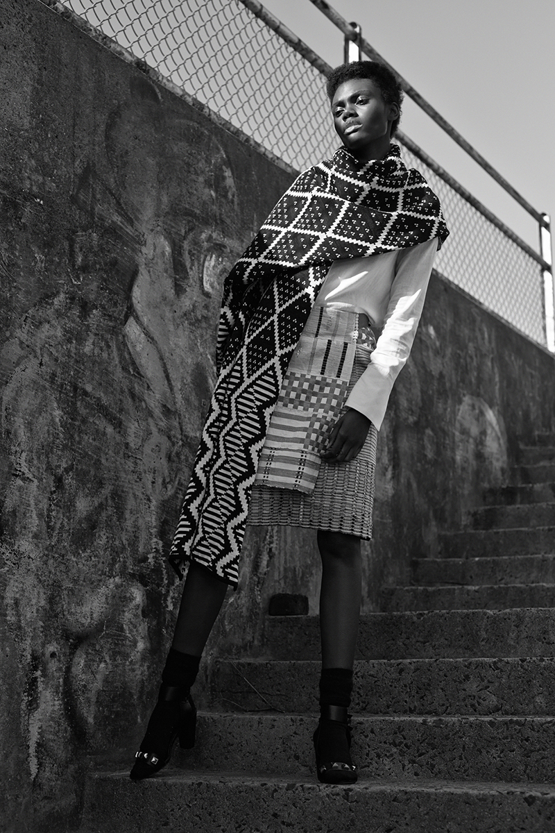 Ivory shirtdress,  AKJP ; black-and-white reversible scarf,  MaXhosa by Laduma ; burgundy, blue and cream wrap skirt,  African Mosaique ; black socks and shoes (worn throughout), stylist's own