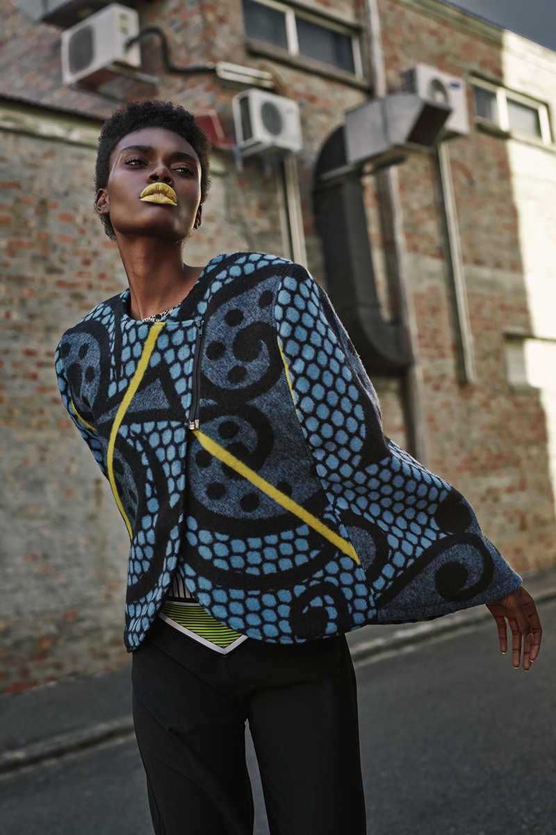Blue, black and yellow cape,  Thabo Makhetha ; black pants with yellow, black and white print detail,  Leigh Schubert