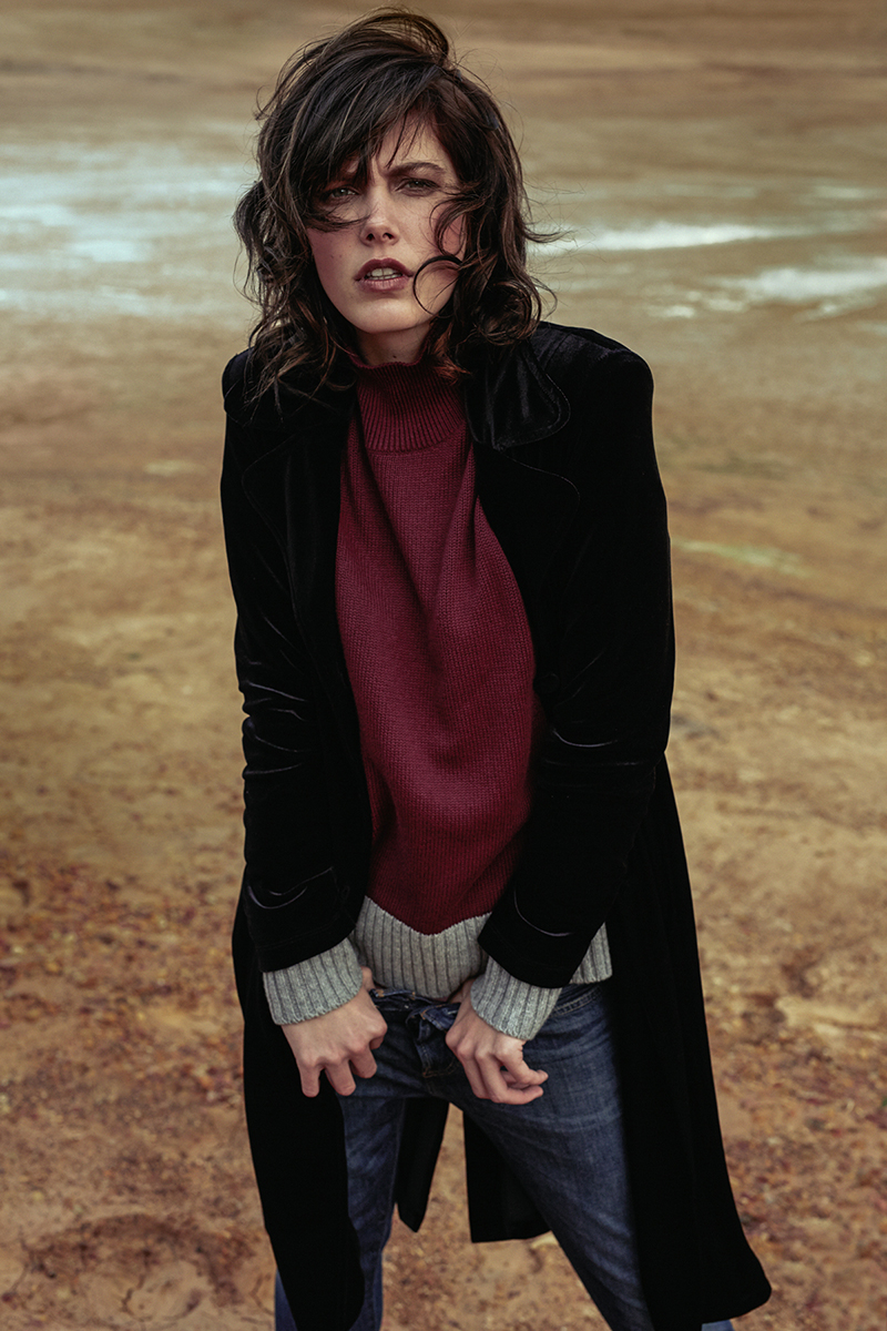 Burgundy-and-grey knit jersey,  Poetry ; black velvet trench coat,  Habits ; navy blue jeans,  Levi's