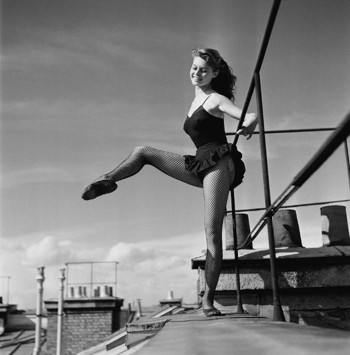 18-year-old Brigitte Bardot dancing on a roof in 1952
