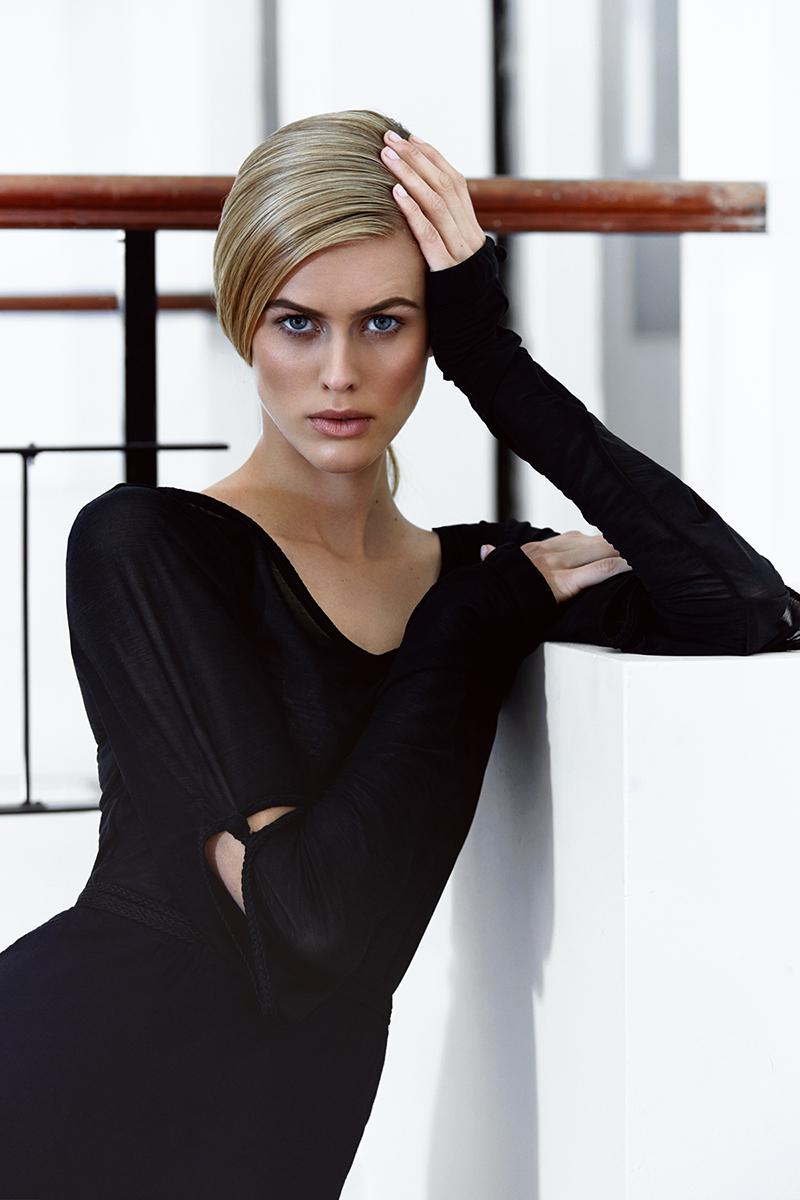 Black pin-up sleeve top and black petal-hem skirt, Lara Klawikowski