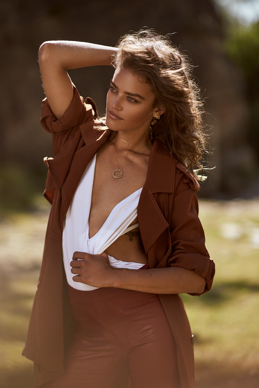 Swimsuit,  Beach Cult ; leather trousers (as before),  Tom Tailor ; trench coat, Chelsea Design; gold earrings (as before),  Anna Rosholt