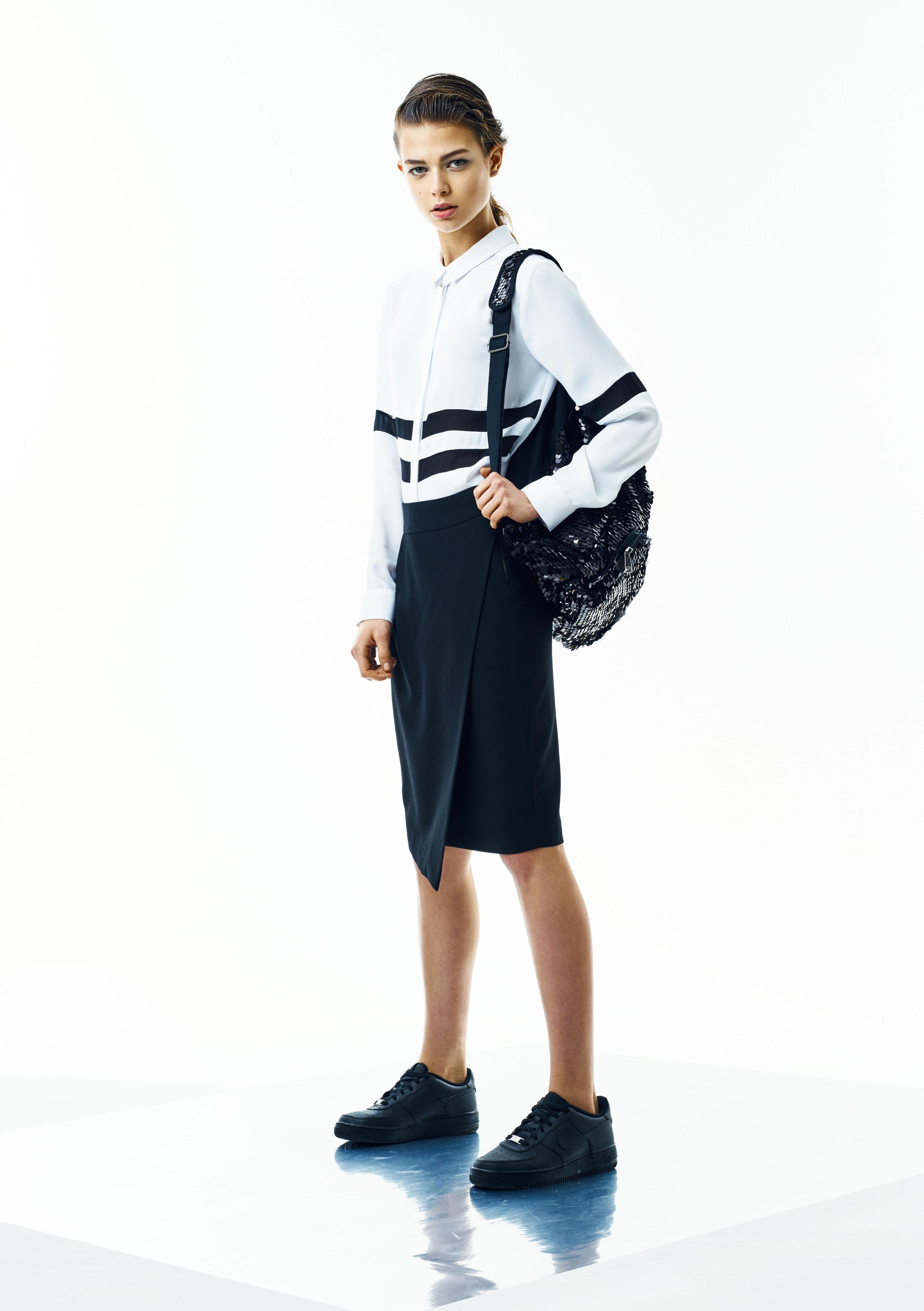 Blouse, Steffen Schraut; skirt, Wunderwerk; backpack,CeNoir;necklace,Yael;shoes, Nike
