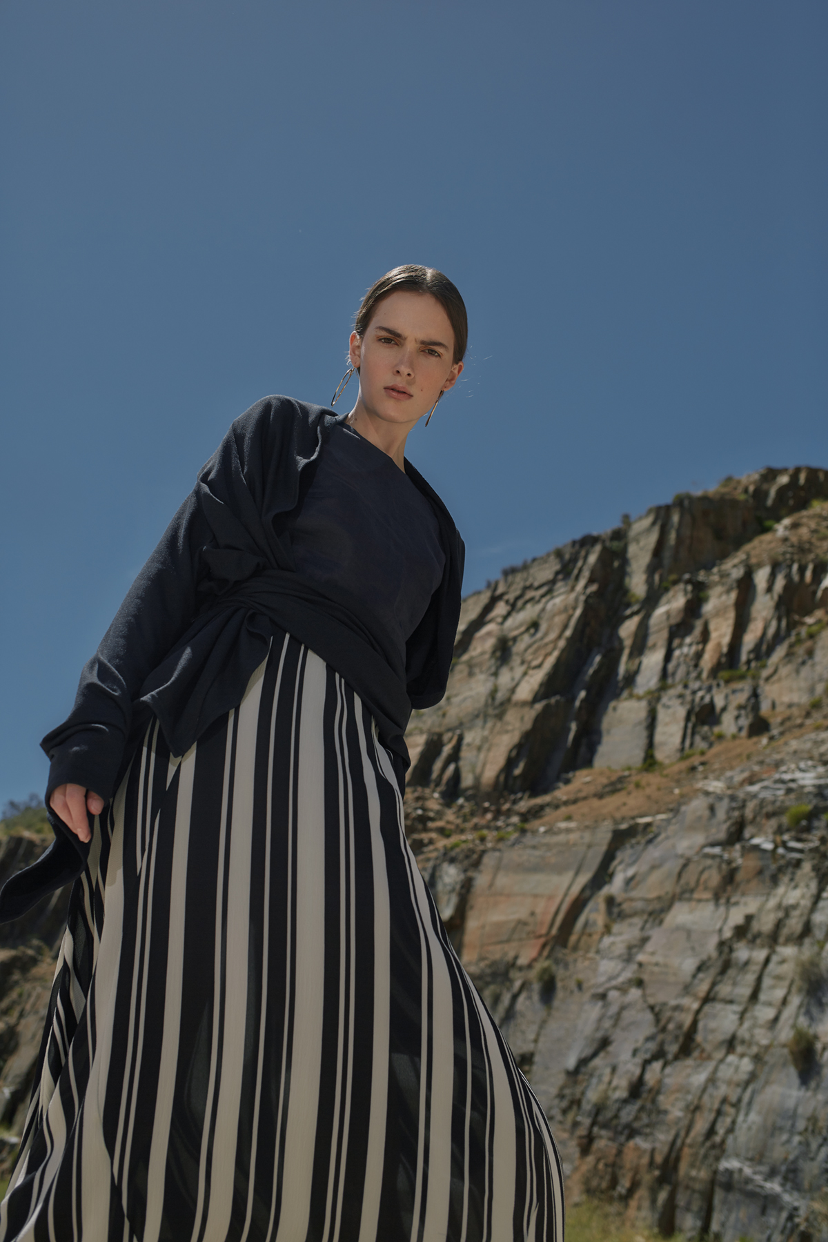 Navy linen tee,Amanda Laird Cherry; black wrap jersey, Colleen Eitzen; black-and-white stripe skirt, The Space; gold hoop earrings, stylist's own
