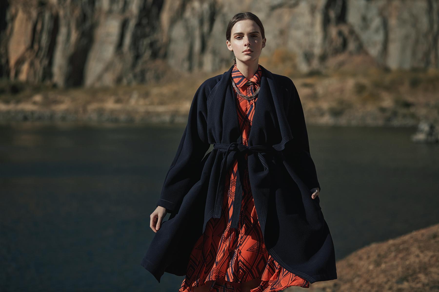 Orange-and-navy print shirt dress, Leigh Schubert; navy coat, C  olleen Eitzen; bead necklace, The Space