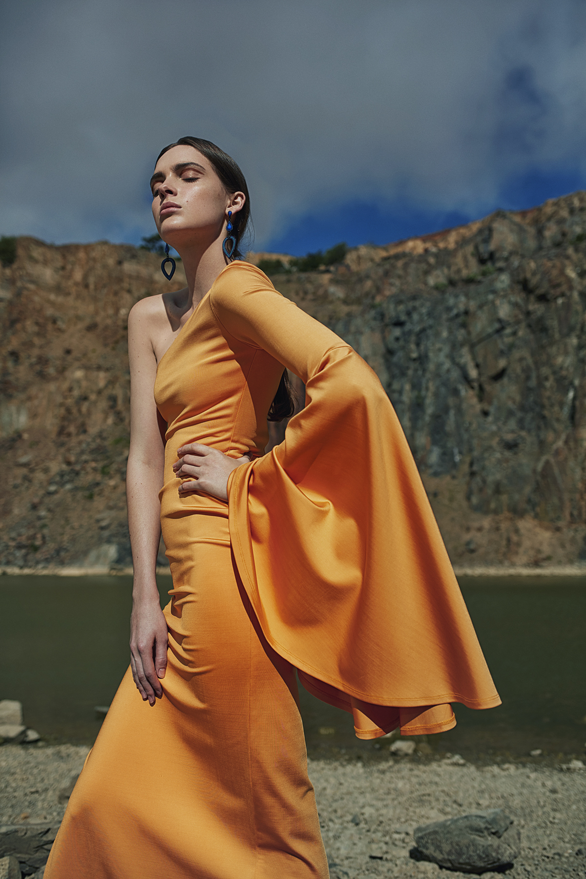 Orange one-shoulder dress, Michael Maven; blue-and-purple stone earrings, stylist's own