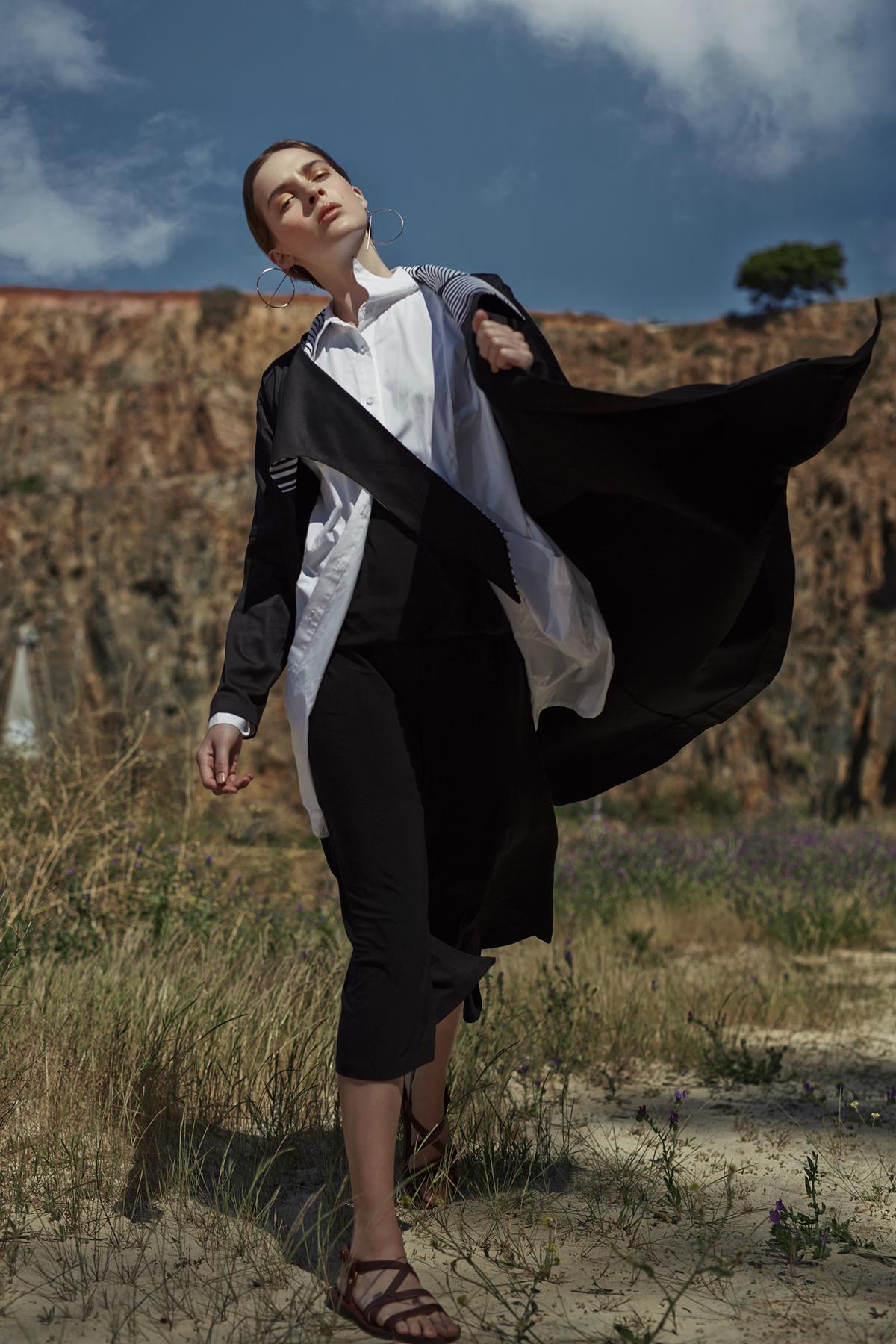 White shirt,  Amanda Laird Cherry; b  lack jumpsuit, Isabel de Villiers; black-and-white coat, Leigh Schubert;  gold hoop earrings, stylist's own