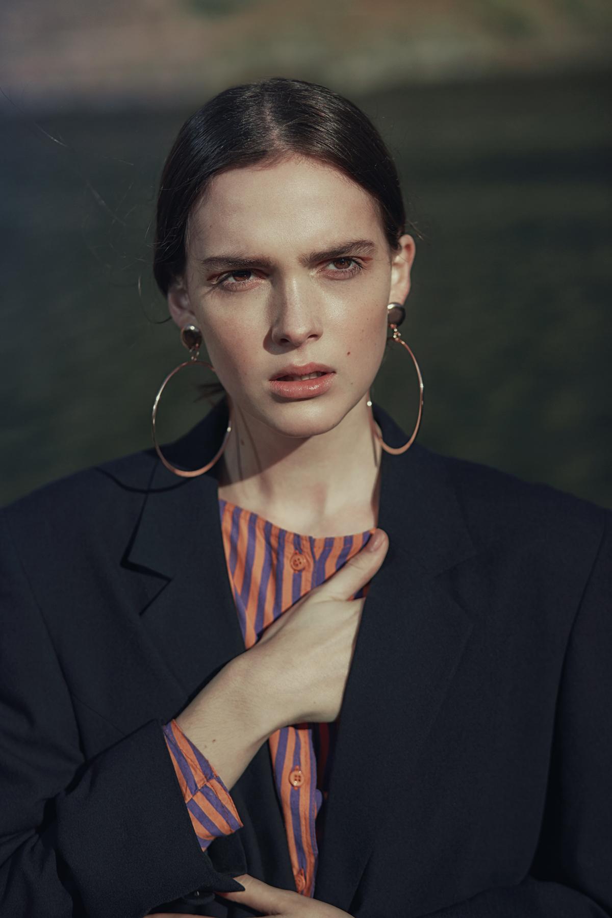 Vintage o  range-and-purple stripe jumpsuit, Roy Curitz;navy blazer, Giorgio;  rose-gold hoop earrings, stylist's own