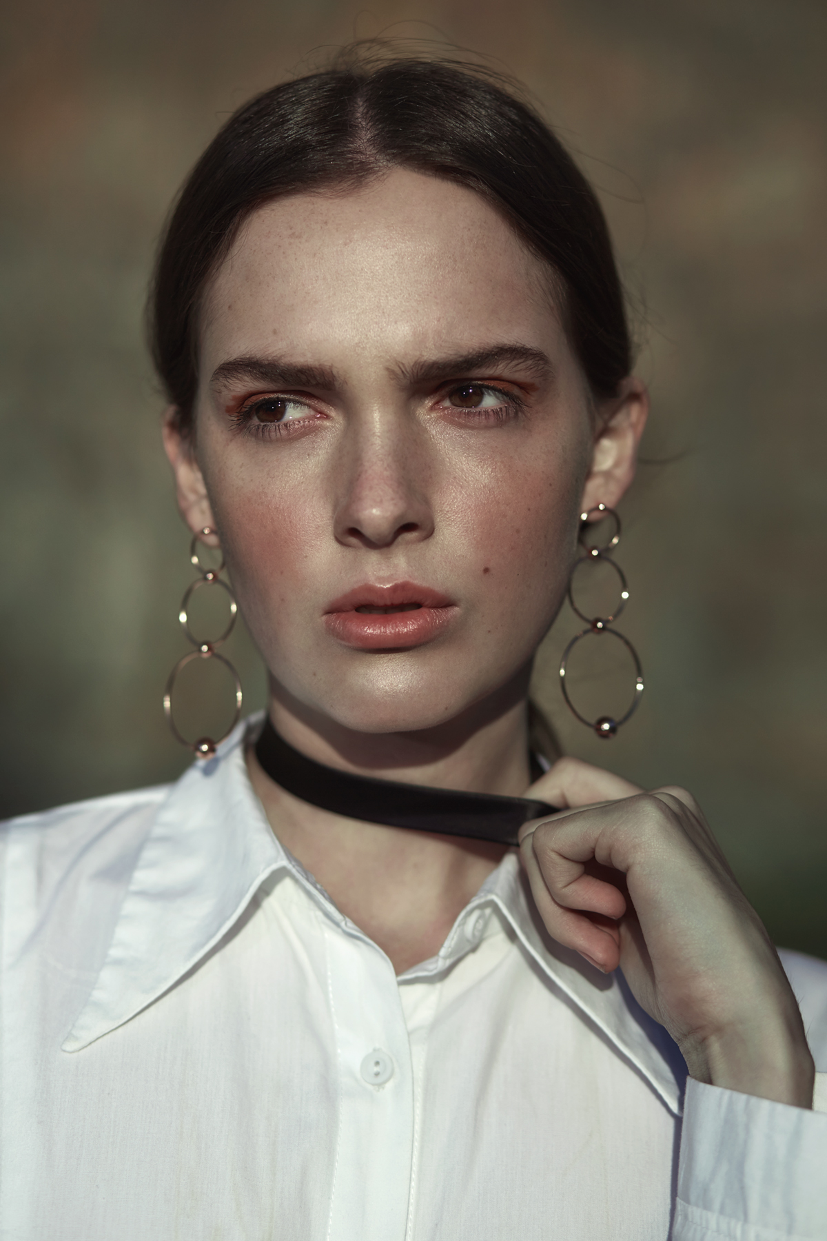 White shirt,Amanda Laird Cherry; black tie (worn as a choker) and rose-gold hoop earrings, stylist's own