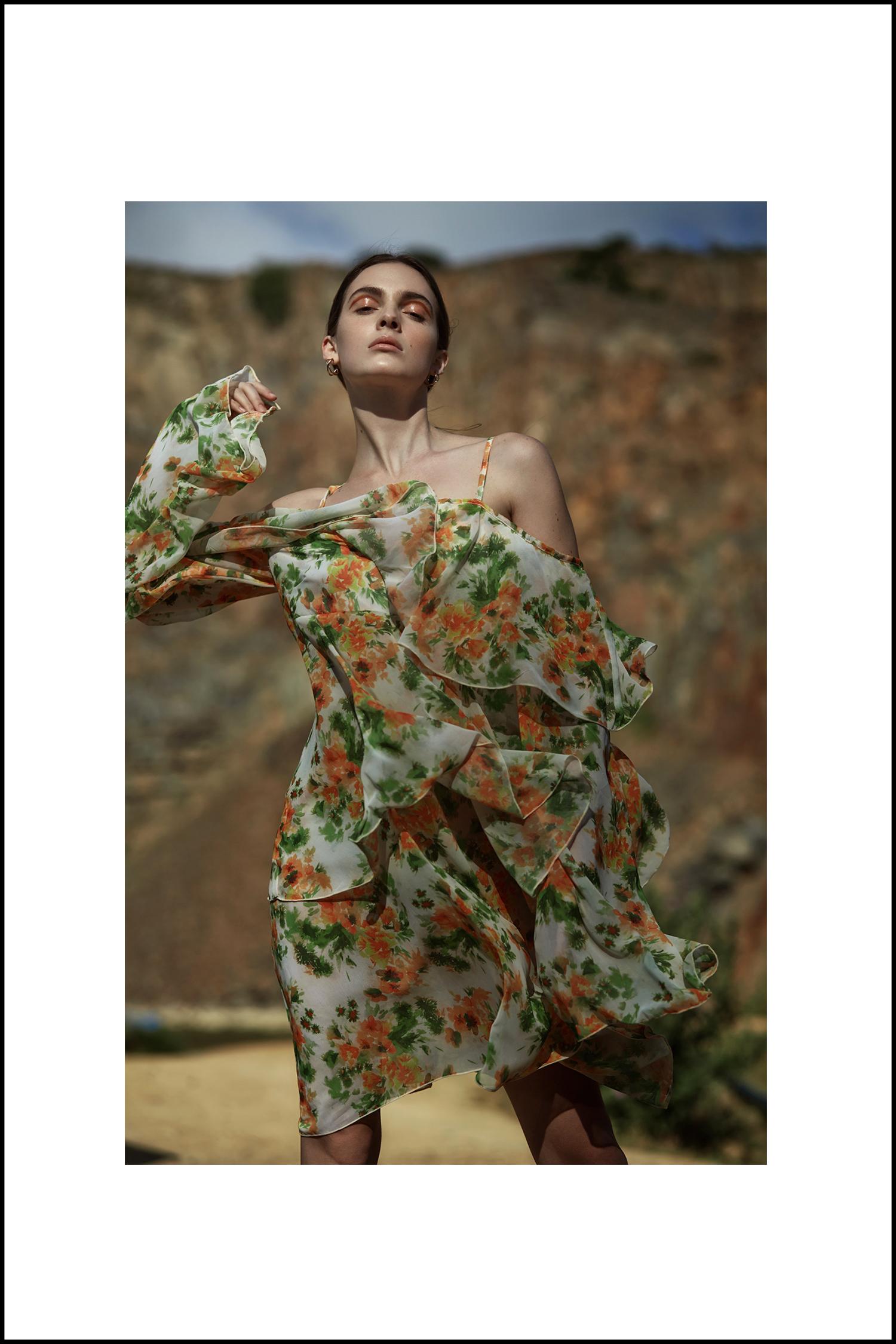 Orange-and-green floral dress, Michael Maven; gold hoop earrings, stylist's own