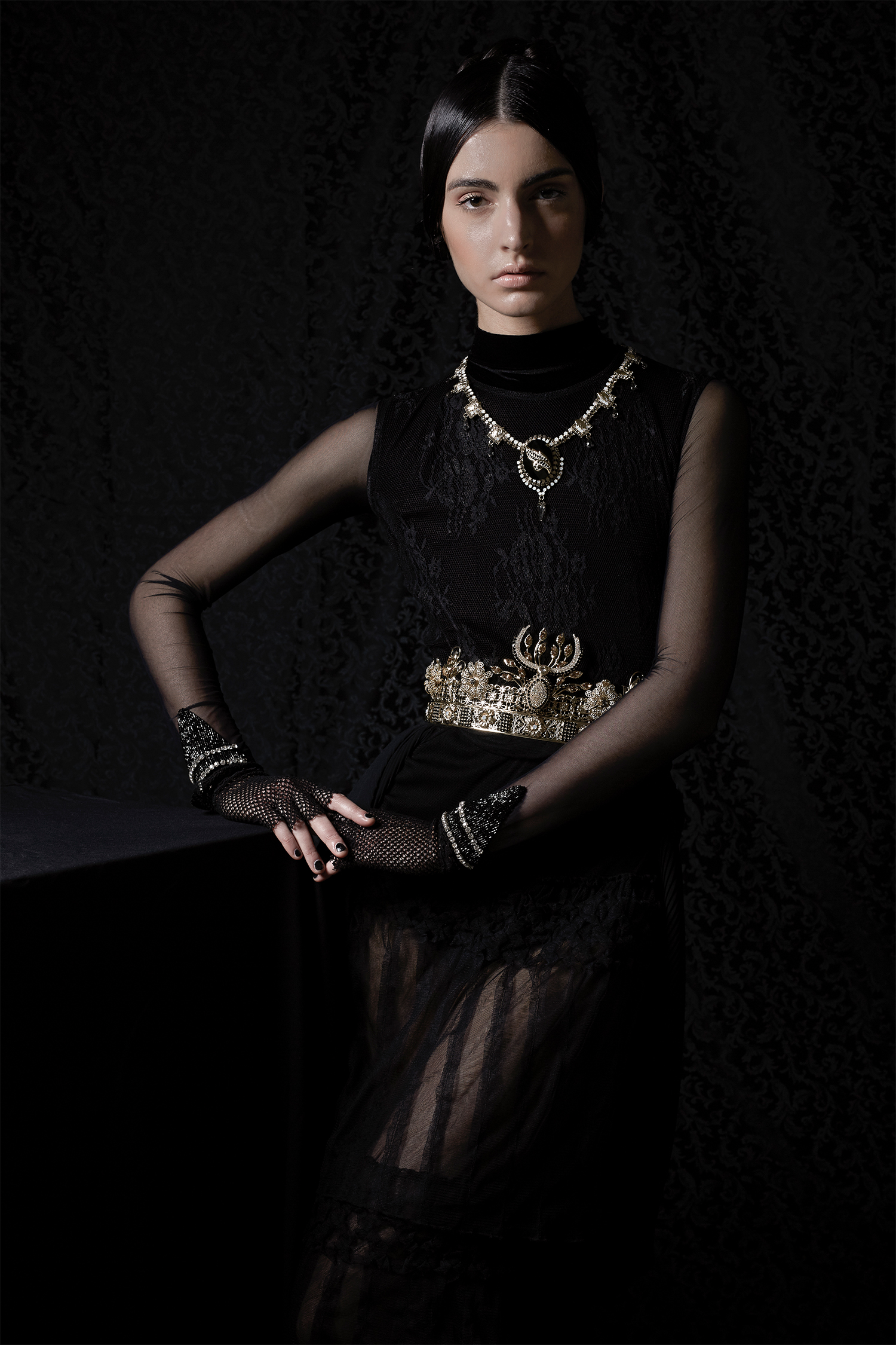 Black dress in lace and tulle,Mori Castello;bodysuit in black velvet with tulle sleeves and jewel embroidery, Freeda Studio; necklace and crown (used as a belt), Vittorio Ceccoli Jewelry