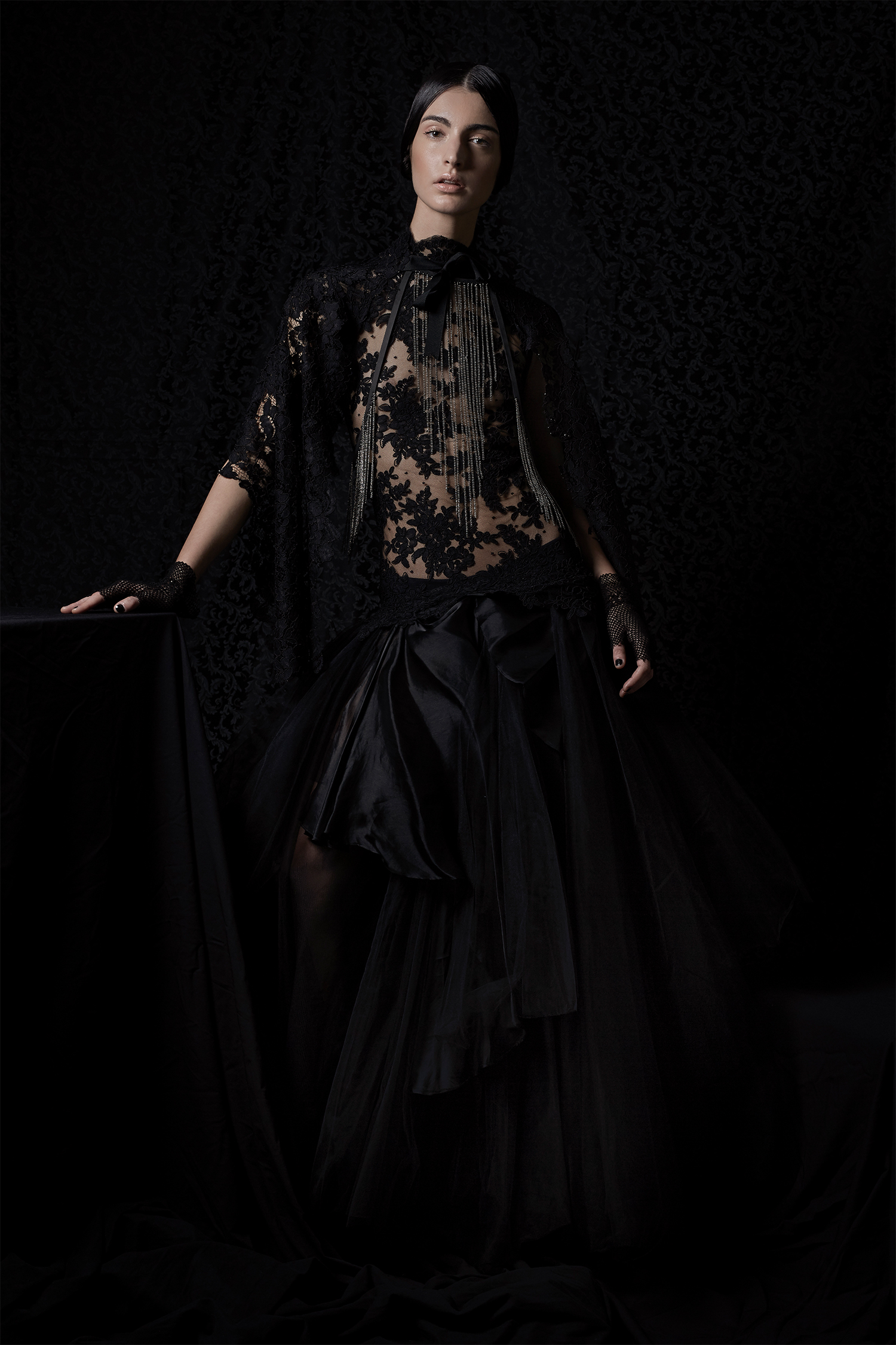 Black dress with lace bodice,Giada Curti; black leather necklace with metal fringe, Zora Romanska