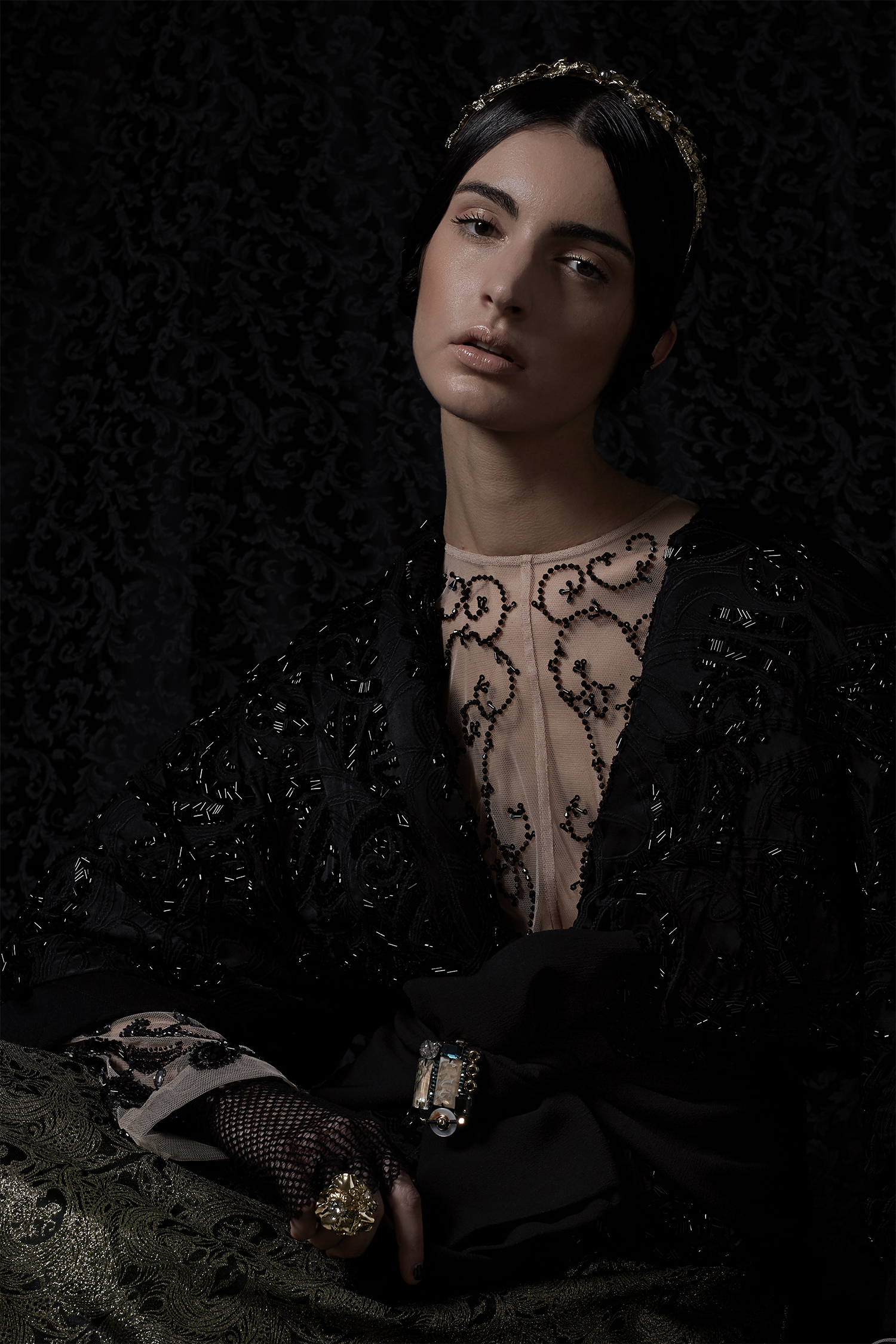 Nude dress with black stone detail, Mori Castello; black kimono jacket with stone embroidery, Mori Castello; gold brocade skirt, LeitMotiv; brooch, Nocturne Studio; ring and headband, Vittorio Ceccoli Jewelry