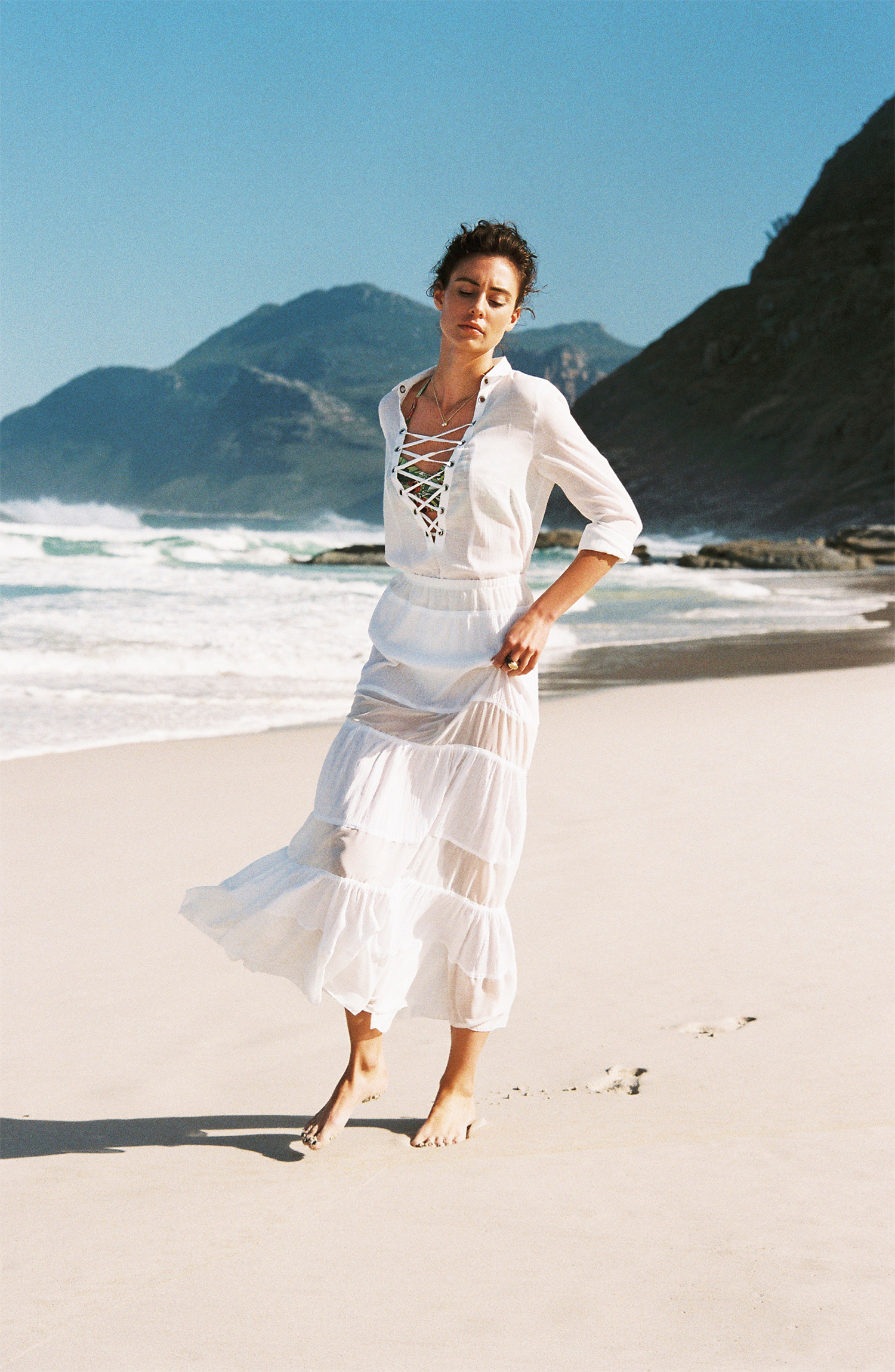 White shirt and white long skirt,  Noël of Me by Demet Karatas ; green swimsuit top,  Beach Cult ;gold plated dome ebony based ring (as before),  Ambra