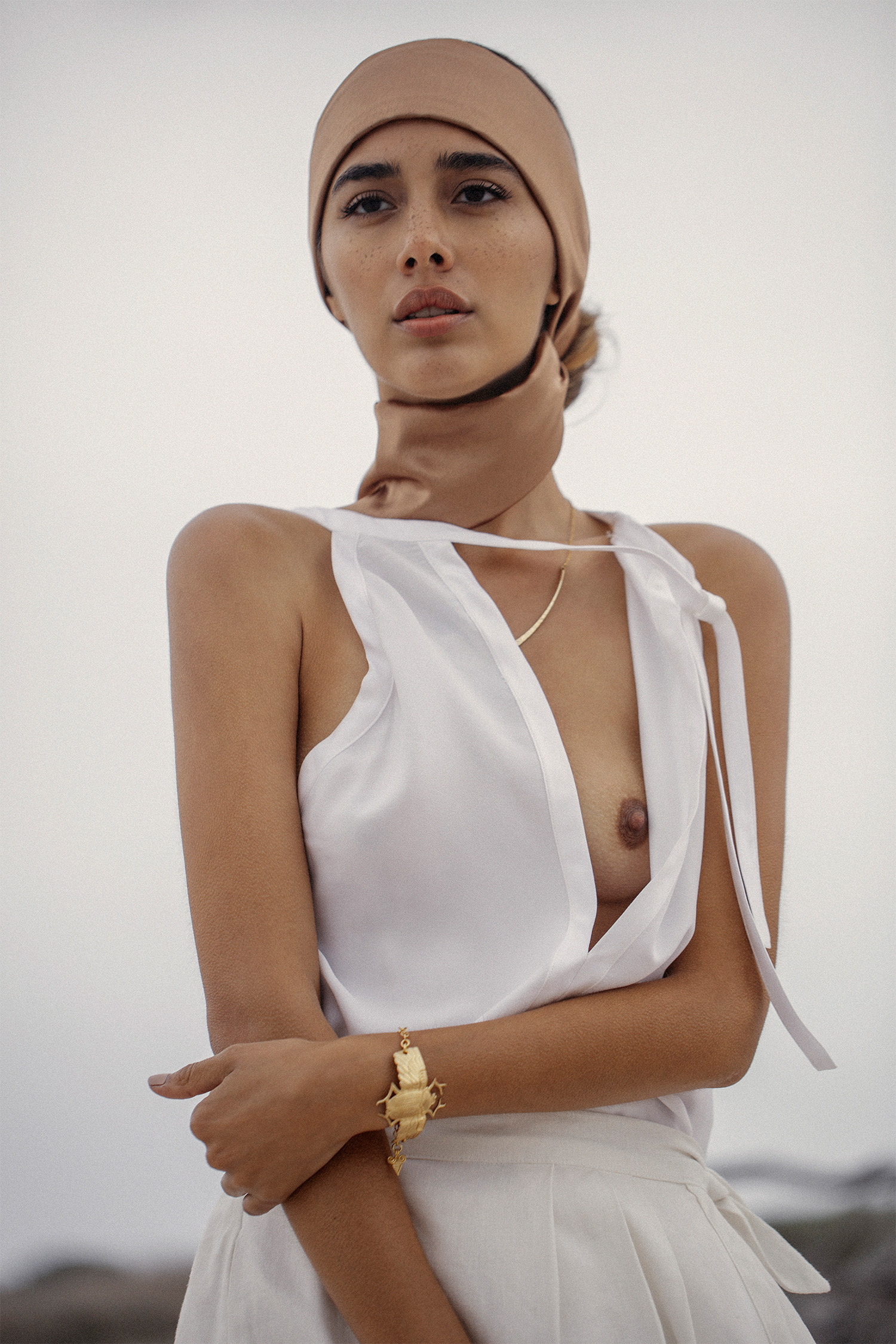 White top, Noël of Me by Demet Karatas; white skirt, Margot Molyneux at Mungo & Jemima; white trousers, vintage at Nevernew; necklace and bracelet, Sarah Mulder Jewelry; head wrap, stylist's own
