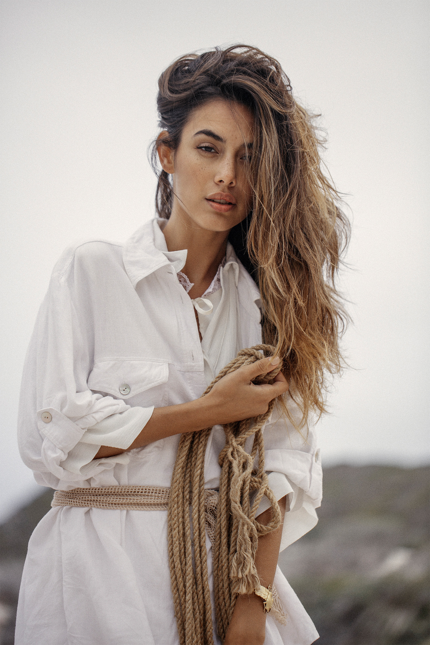White silk dress with lace collar, Noël of Me by Demet Karatas; white camisole, Kokomo at Mungo & Jemima; white shirt, vintage at Nevernew; scarf (worn as a belt), stylist's own; necklace and bracelet, Sarah Mulder Jewelry