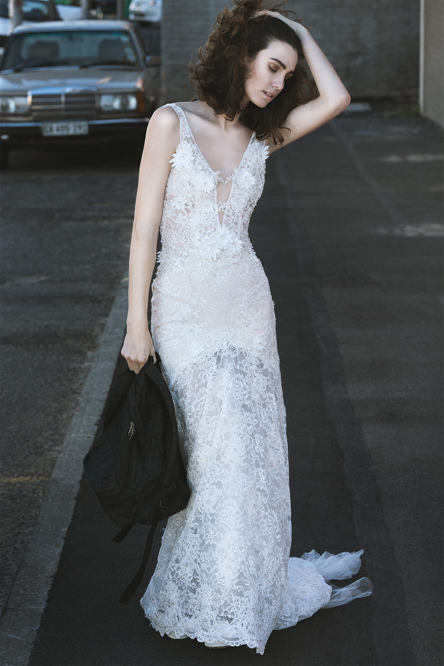 Vintage lace gown with 3D flowers and sheer low back,Cindy Bam; bag, Vans