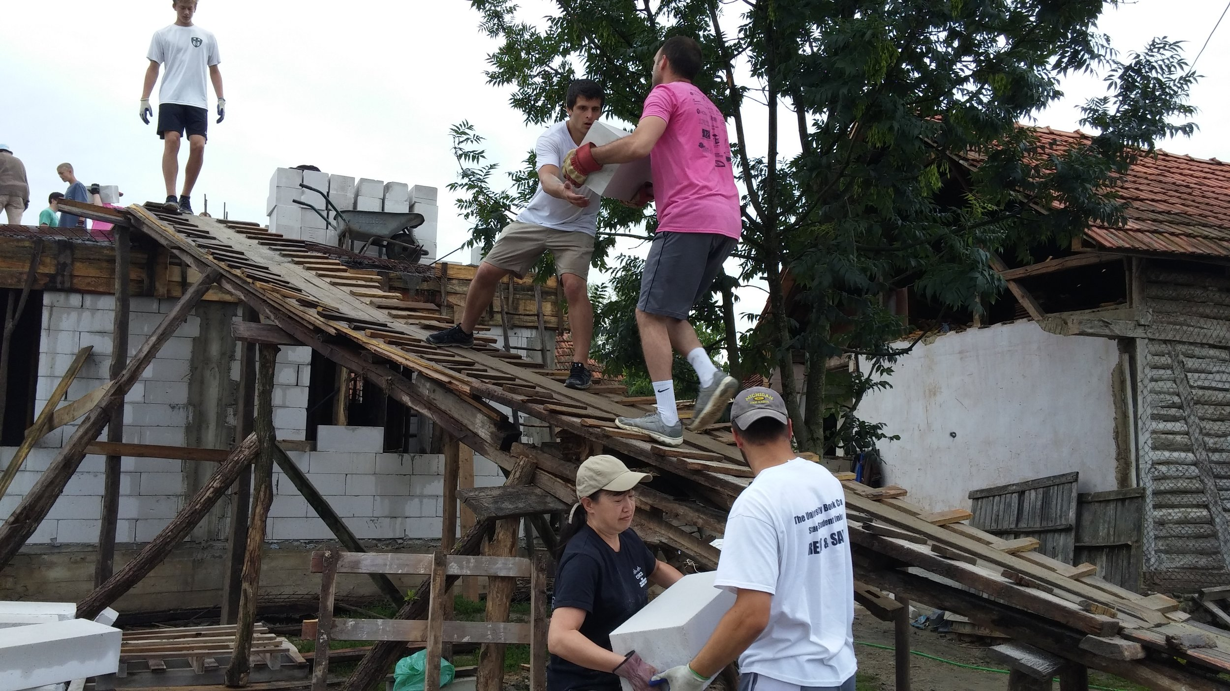 Aaron and a team from Fourth Presbyterian Church work on the Alexi family home.